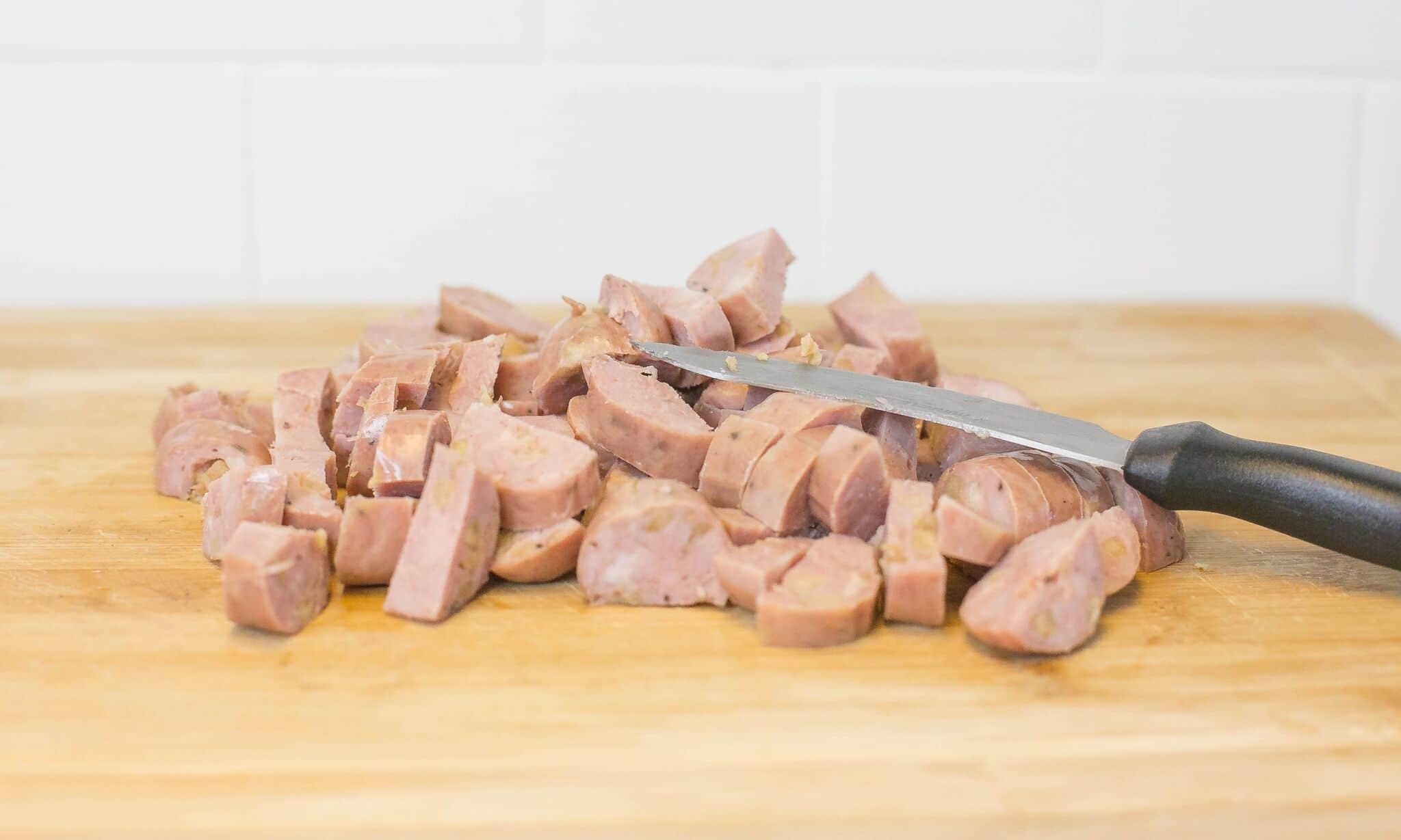 Slice sausage and set aside.