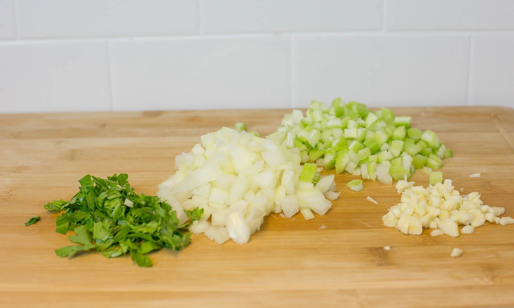 Chop onions, celery, parsley and garlic; set aside.