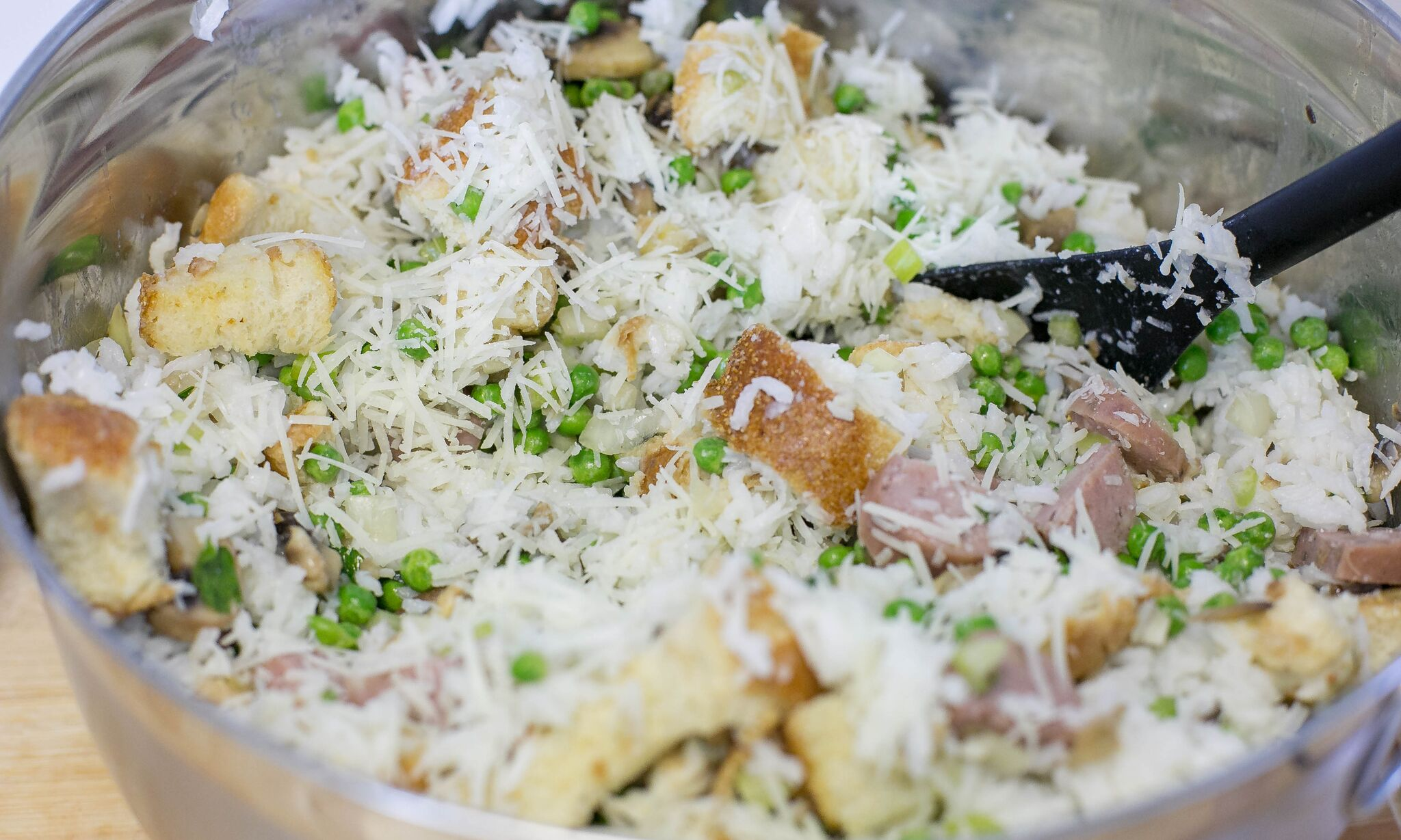 Add cooked rice and one cup of grated Pecronio Romano to vegetable and bread mixture.