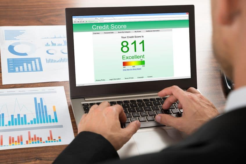 40245734 - close-up of a businessman checking credit score online on laptop