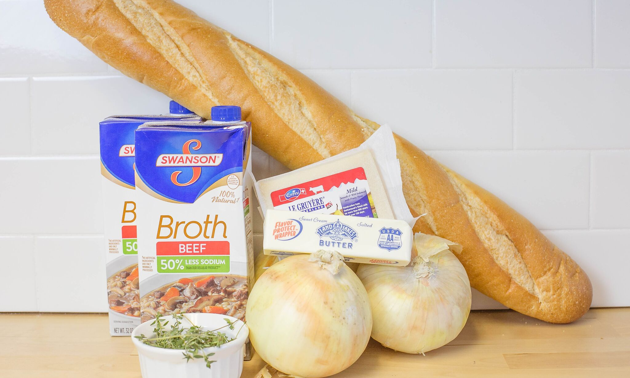 Assemble your ingredients, sweet onions, butter, beef stock, salt, pepper, Gruyère, sliced cheese, Italian bread and fresh or dried thyme