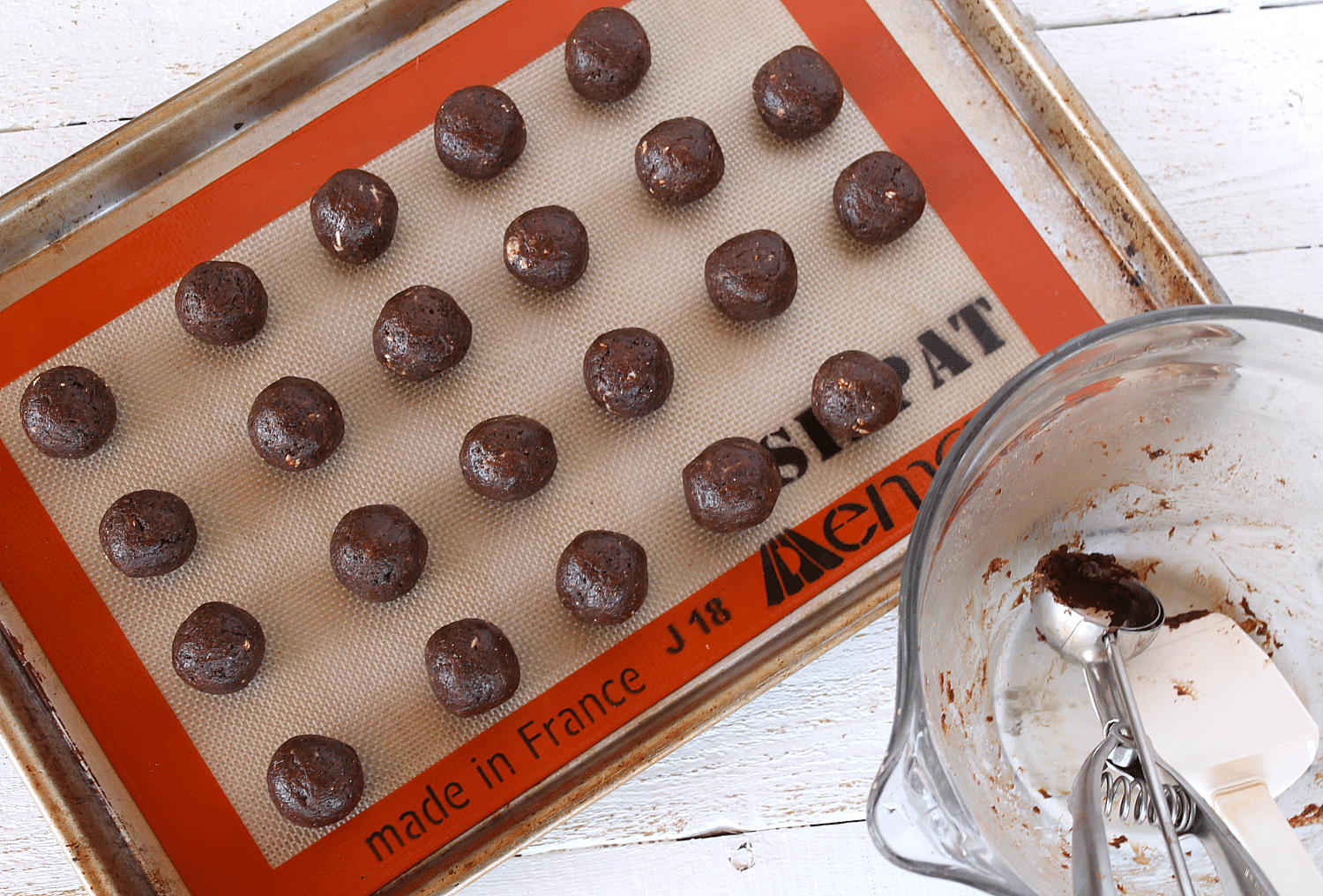 Roll mixture into balls and place on a baking sheet lined with a Silpat liner.