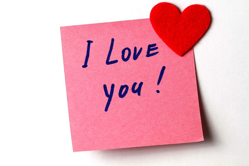 "An ""I Love You"" sticky note attached with a mini heart."