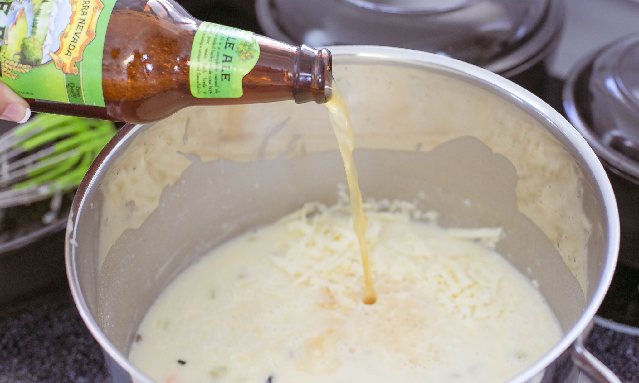 Add the shredded cheddar and beer to pot.