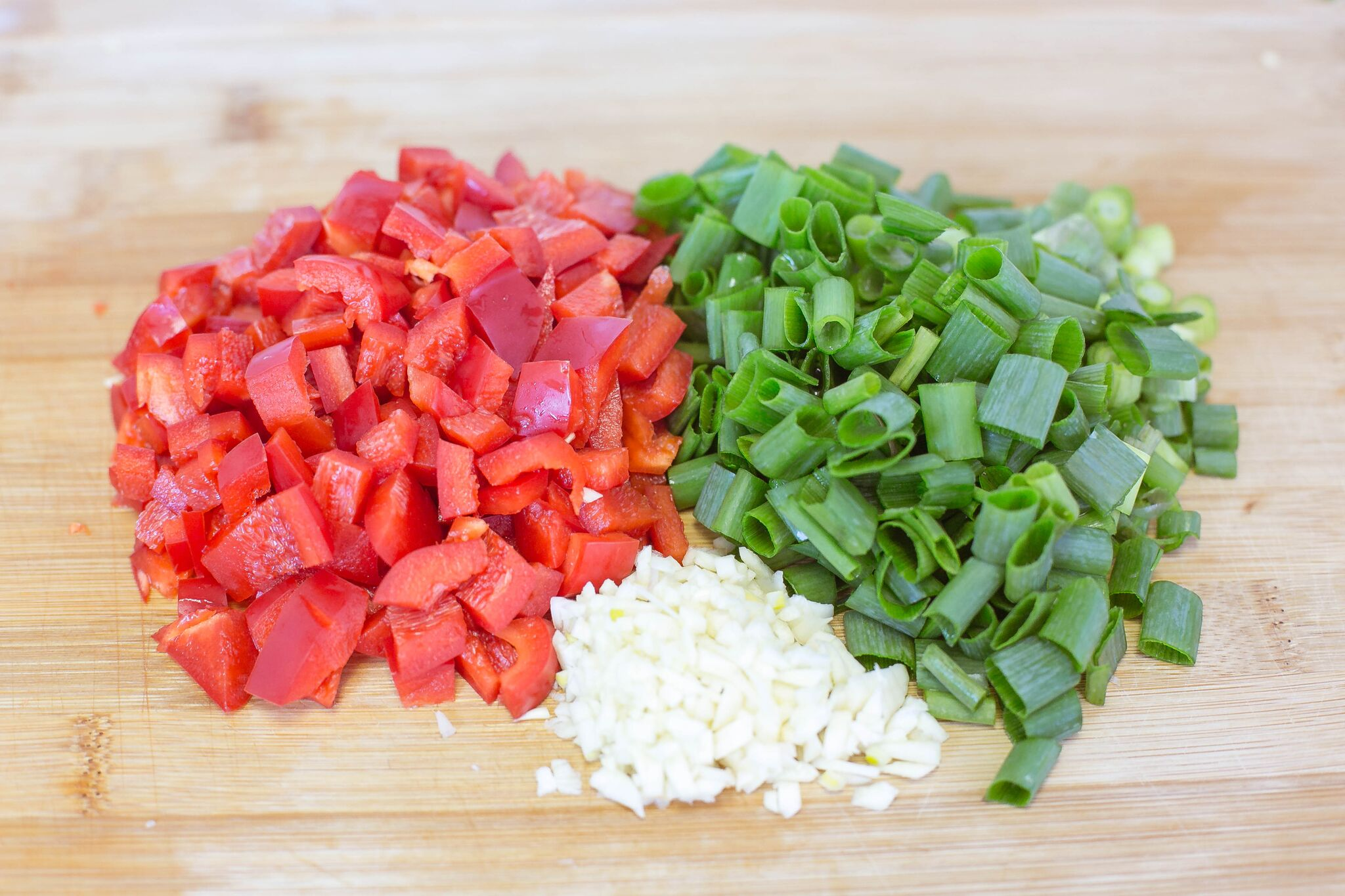 Chop green onions, red pepper and garlic; set aside.