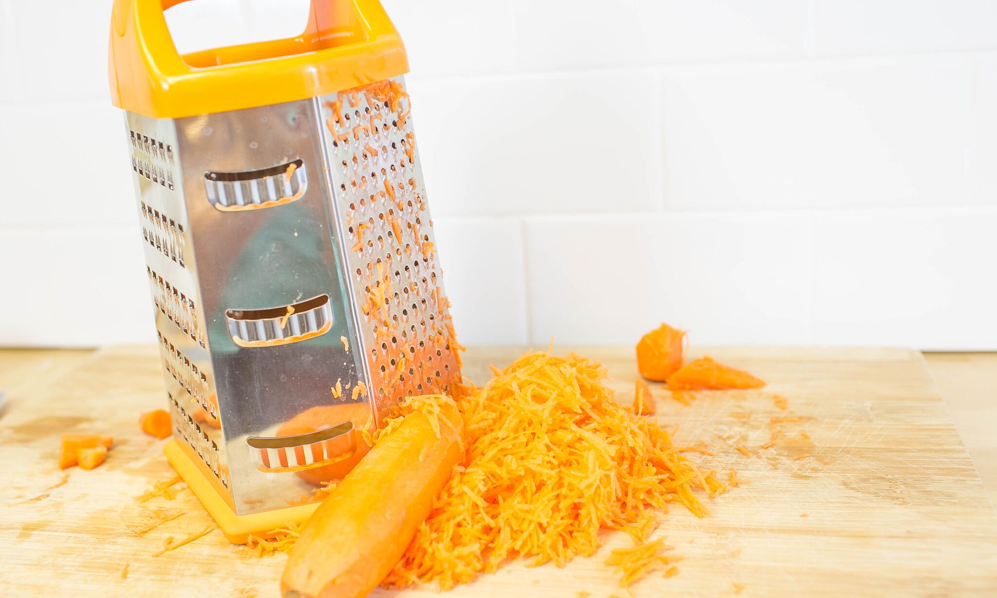 Peel and shred carrots, then set aside.