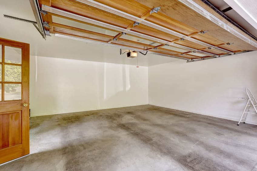A clean garage with a concrete floor.