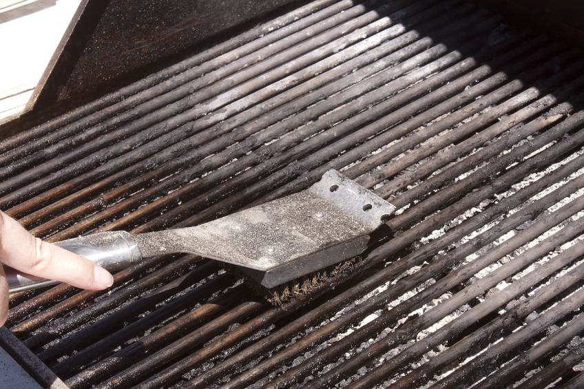 Clean your grill using a special brush.