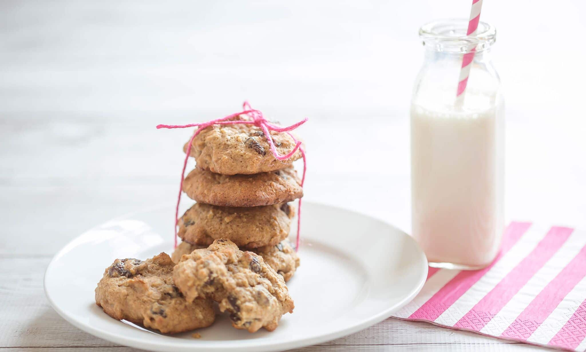 Serve cookies on plate with a glass of milk.