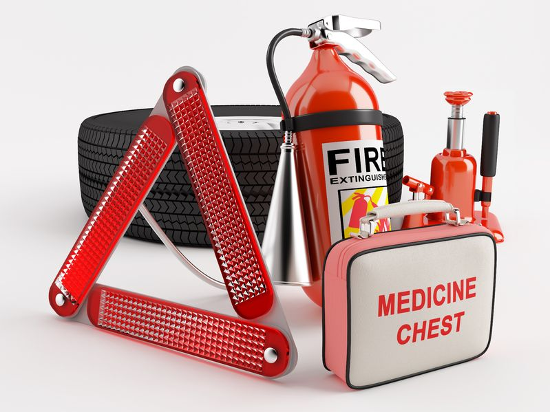 An emergency kit including a first aid kit, fire extinguisher and other materials.