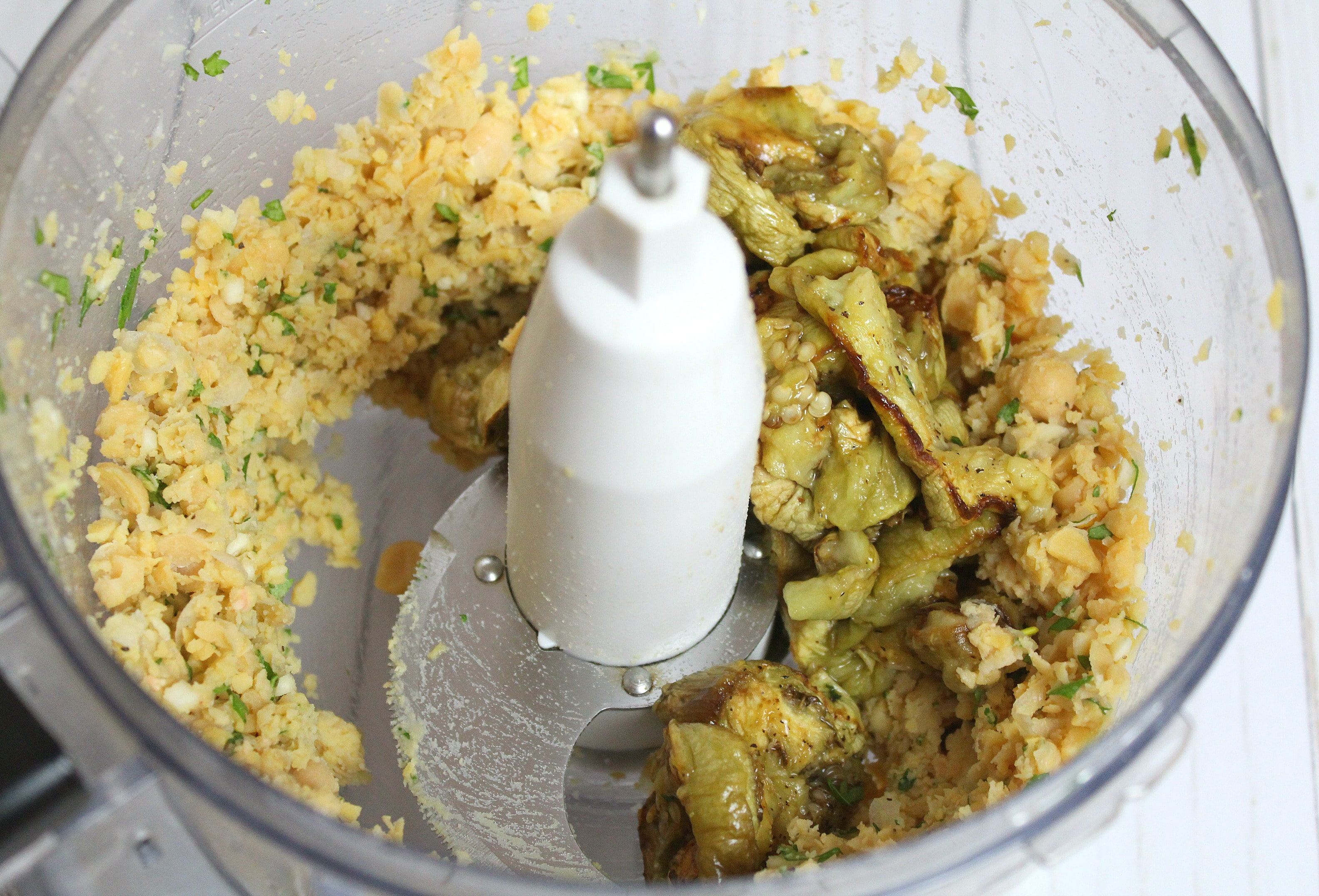 Add eggplant to food processor and blend for a few seconds.