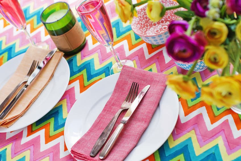Pretty table decor and candles are great ways to add ambiance to your backyard party.