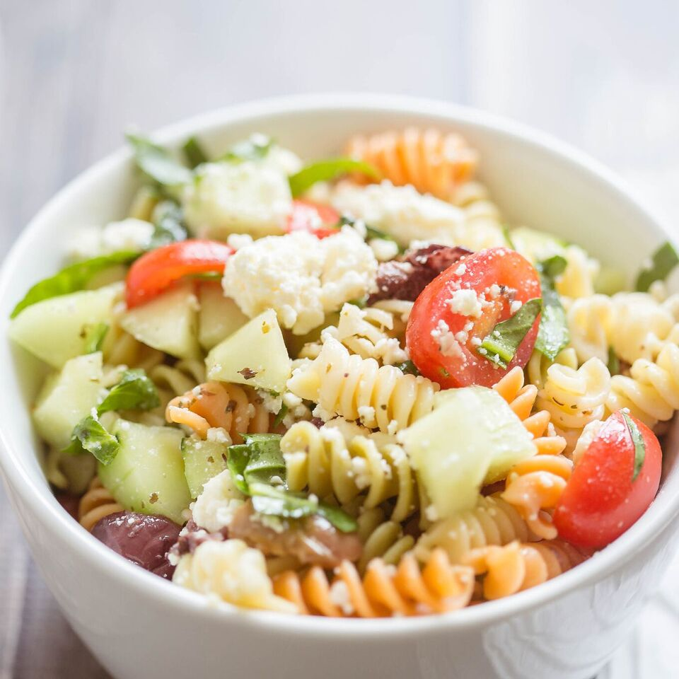 Ready for a fresh summer meal that comes that comes together fast? This flavor-packed Greek Pasta Salad is the perfect solution for lazy nights. It is hearty enough to stand on its own, but it is also great served with grilled chicken, steak or shrimp for a 20-minute meal your whole family will love!