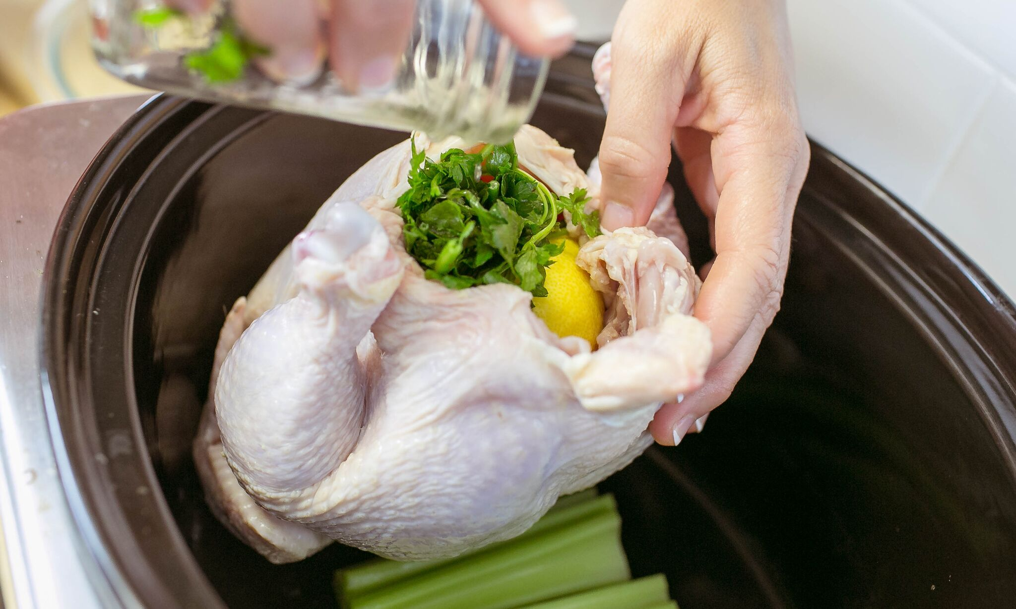 Add lemon juice and parsley to cavity of chicken.