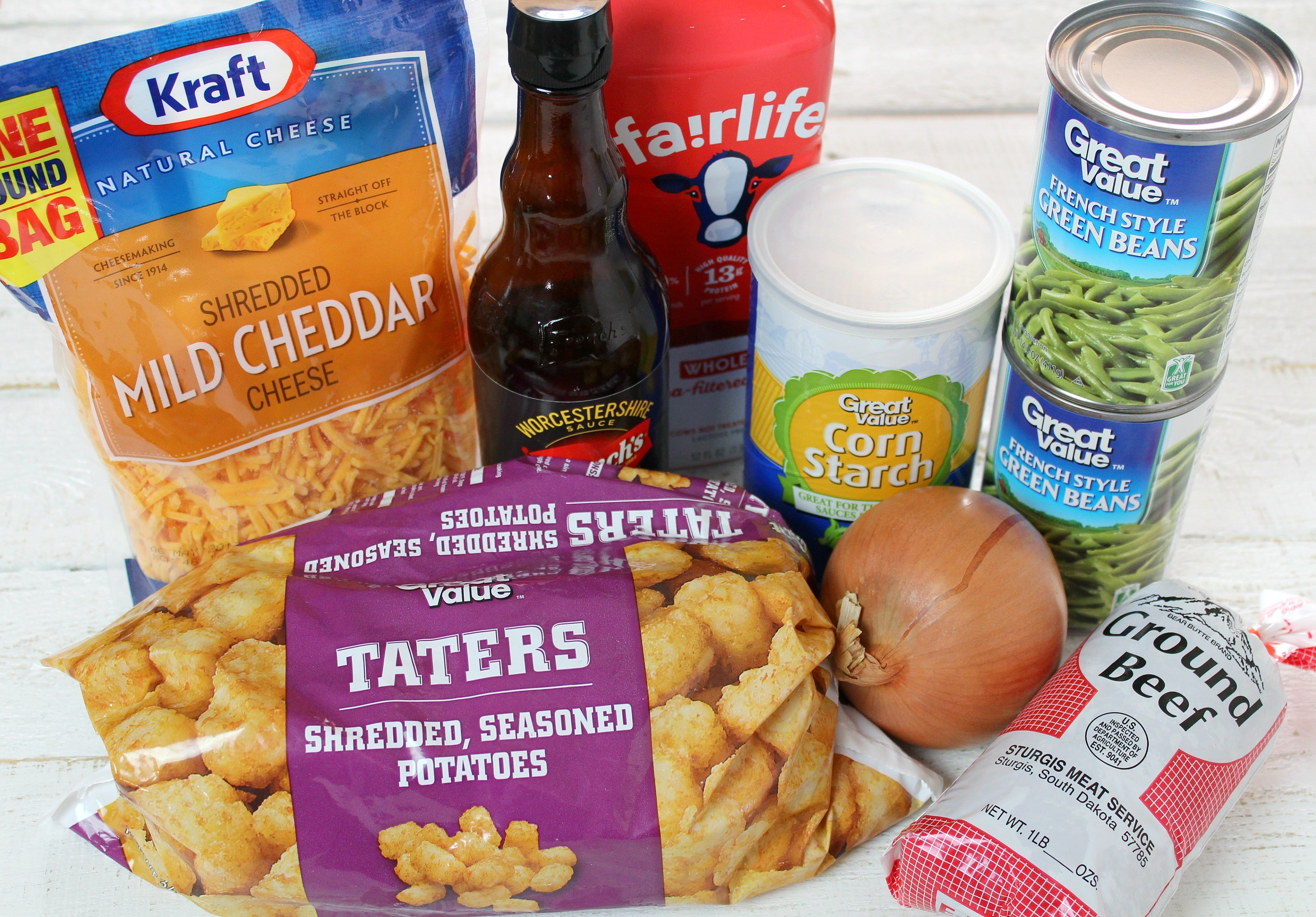 Tater Tot Casserole ingredients - you need shredded mild cheddar cheese, worcester sauce, milk, corn starch, green beans, ground beef and tater tots.