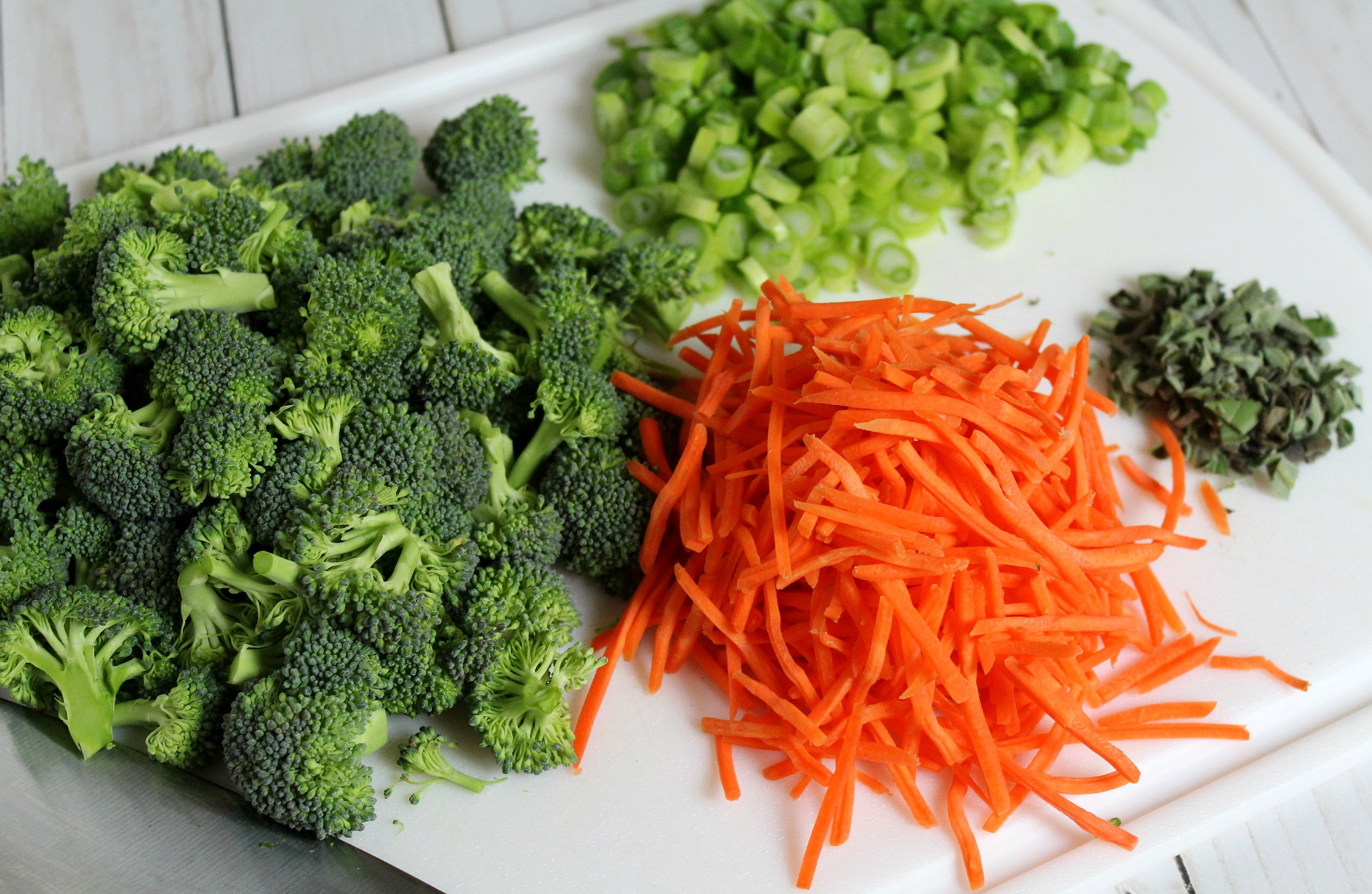 Chop green onion and sage; set aside with broccoli and carrots.