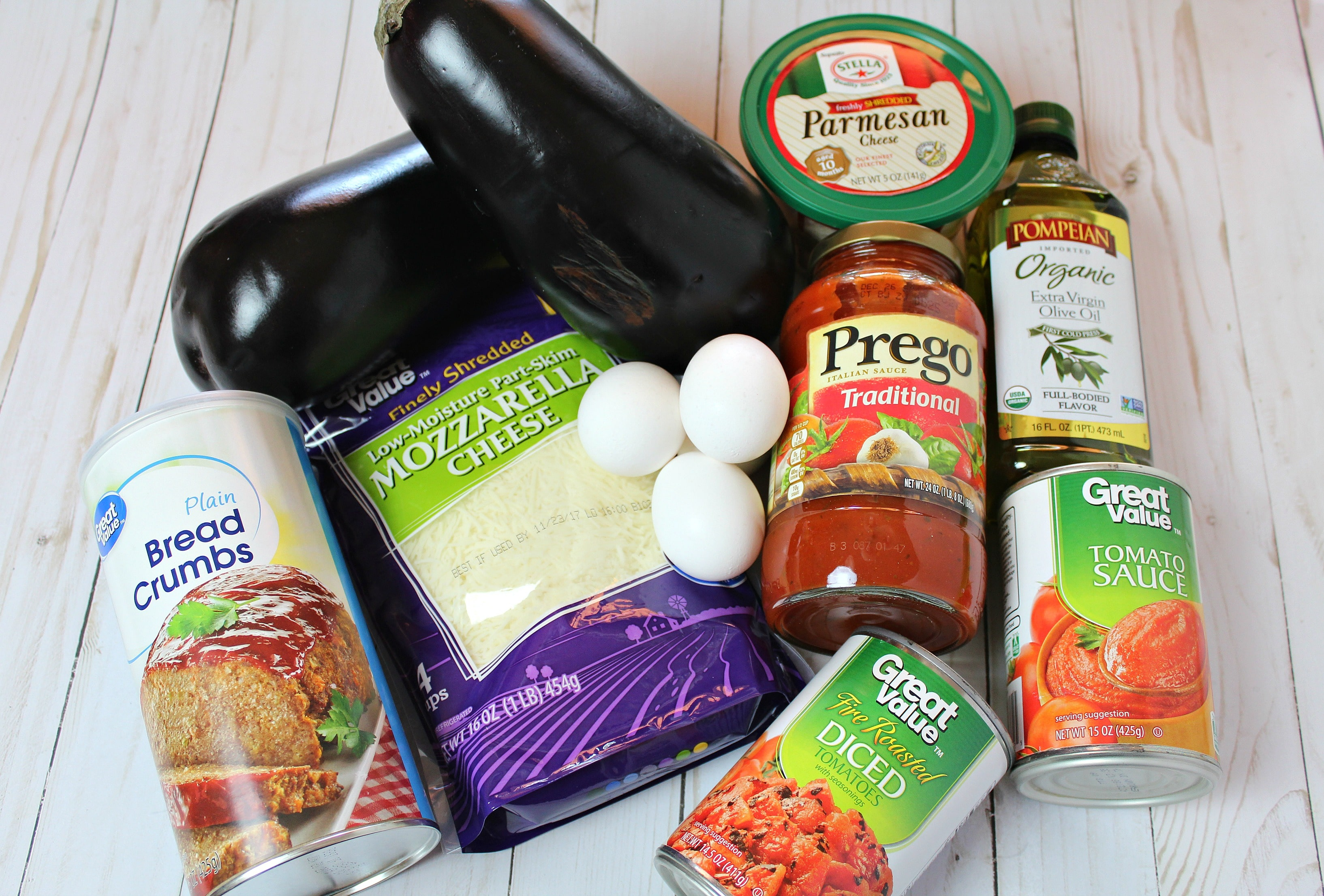 Assemble your ingredients: eggplants, eggs, seasoned dry bread crumbs, olive oil, cooking spray, spaghetti sauce, tomato sauce, fire roasted diced tomatoes, shredded mozzarella cheese, Parmesan cheese and salt.