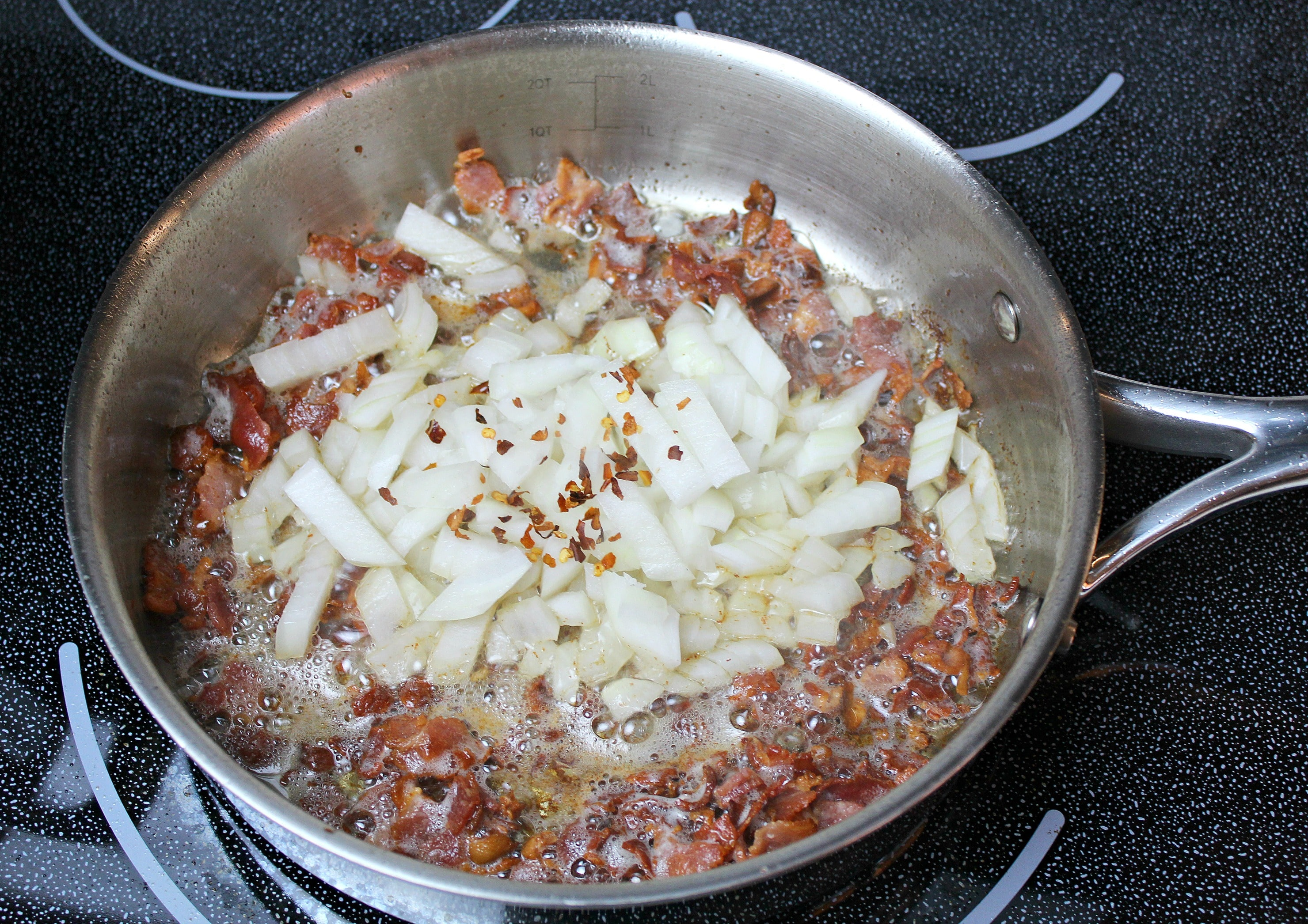 Saute onions with bacon and add red pepper flakes