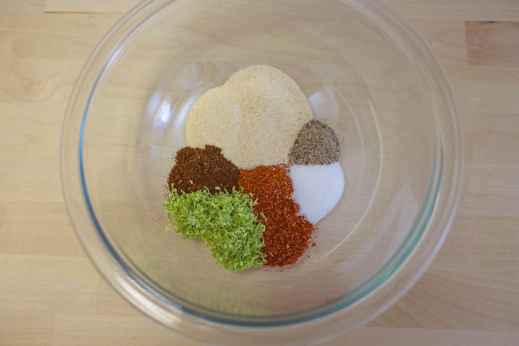 Add cayenne pepper, chili powder, garlic powder, lime zest, salt and pepper to bowl.
