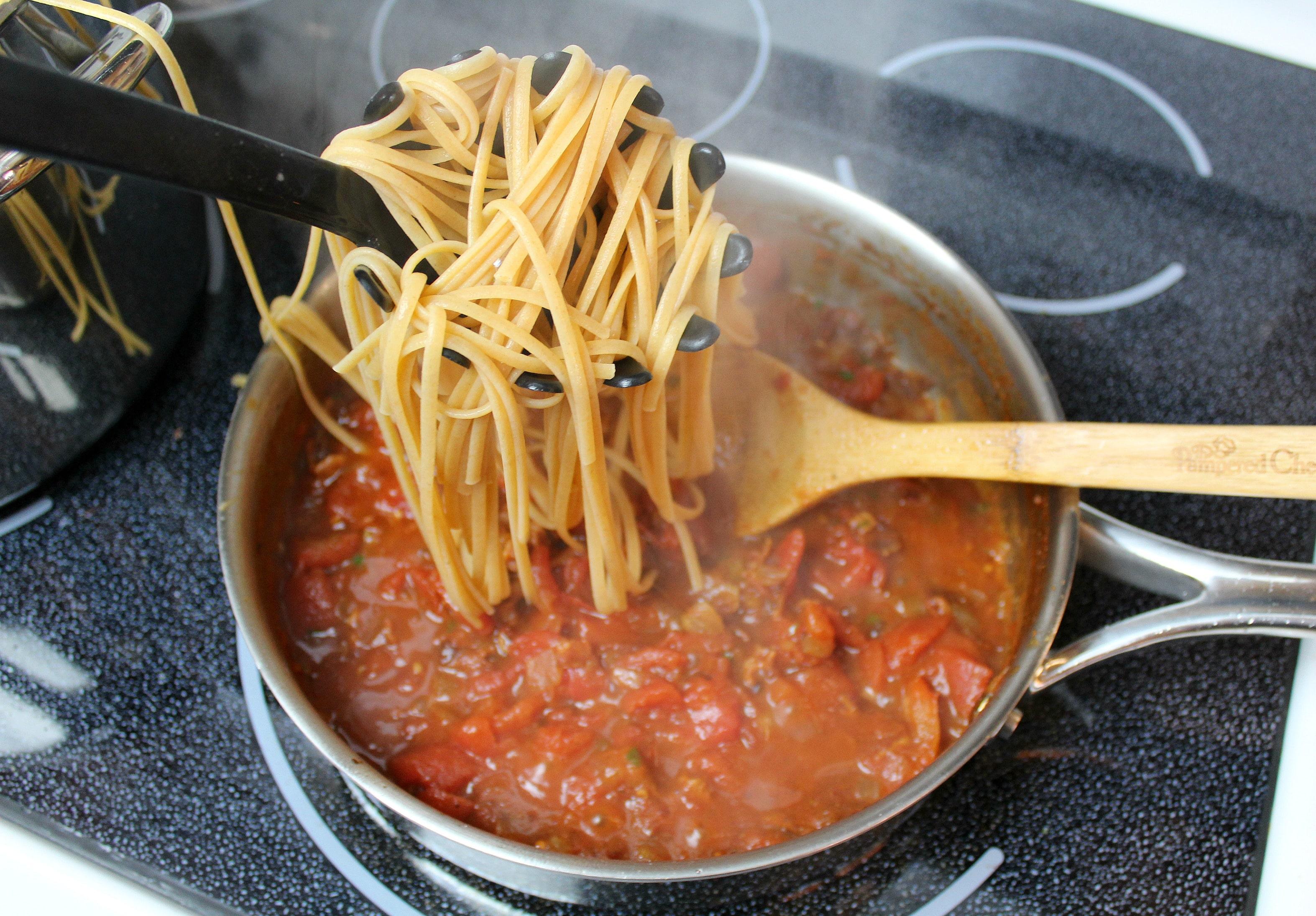 Add pasta to tomato sauce