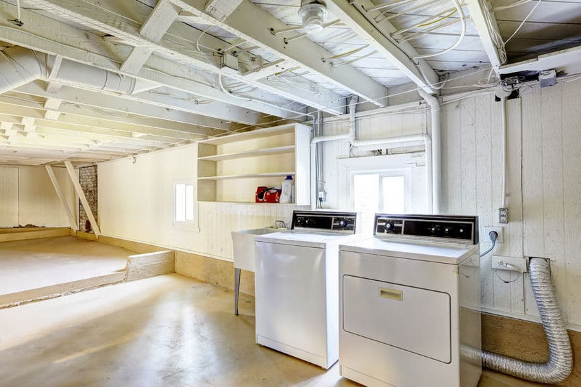 A clean laundry room with a washer and dryer.