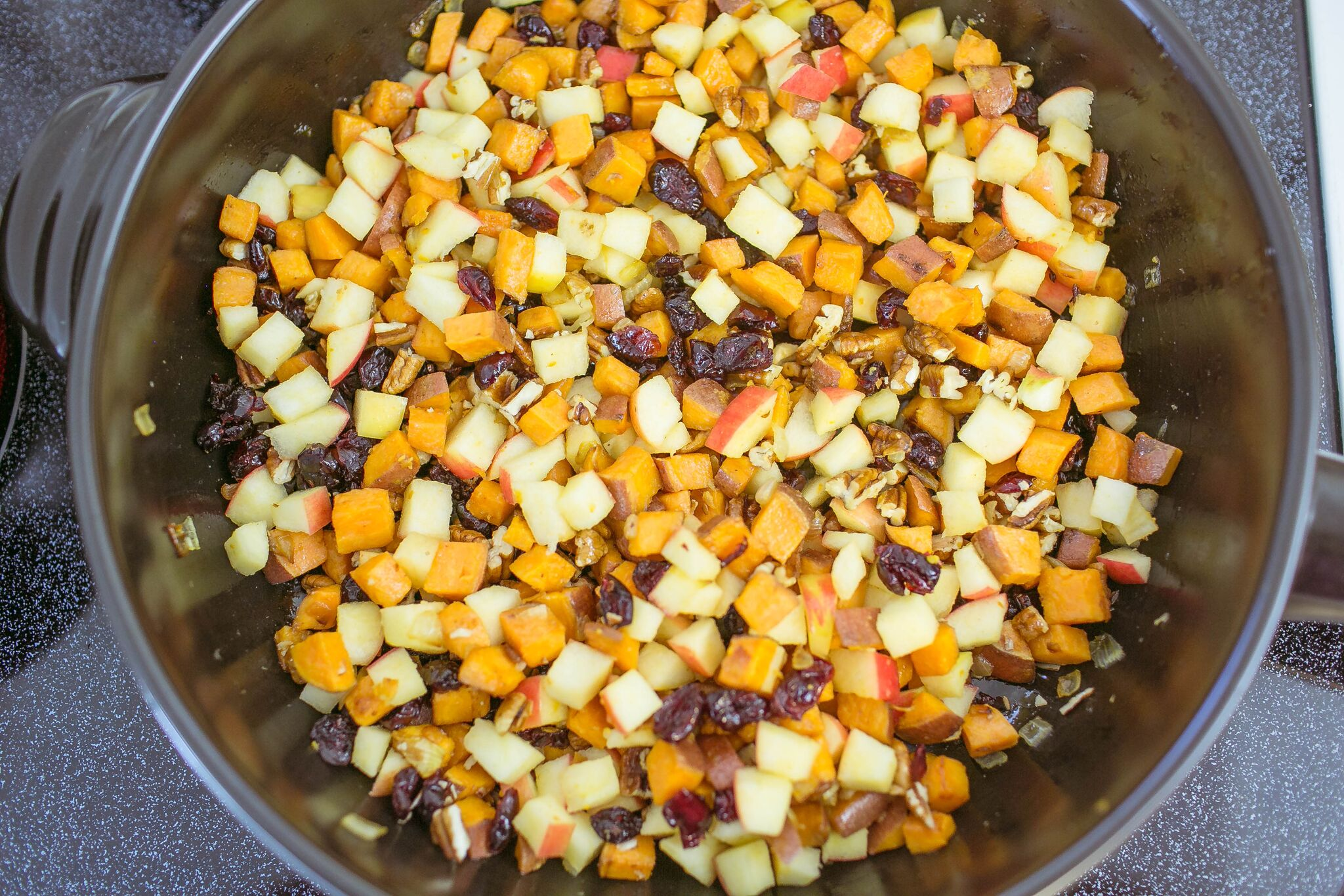 Add butter, the diced apple, chopped pecans and cranberries to pan then stir until well combined.