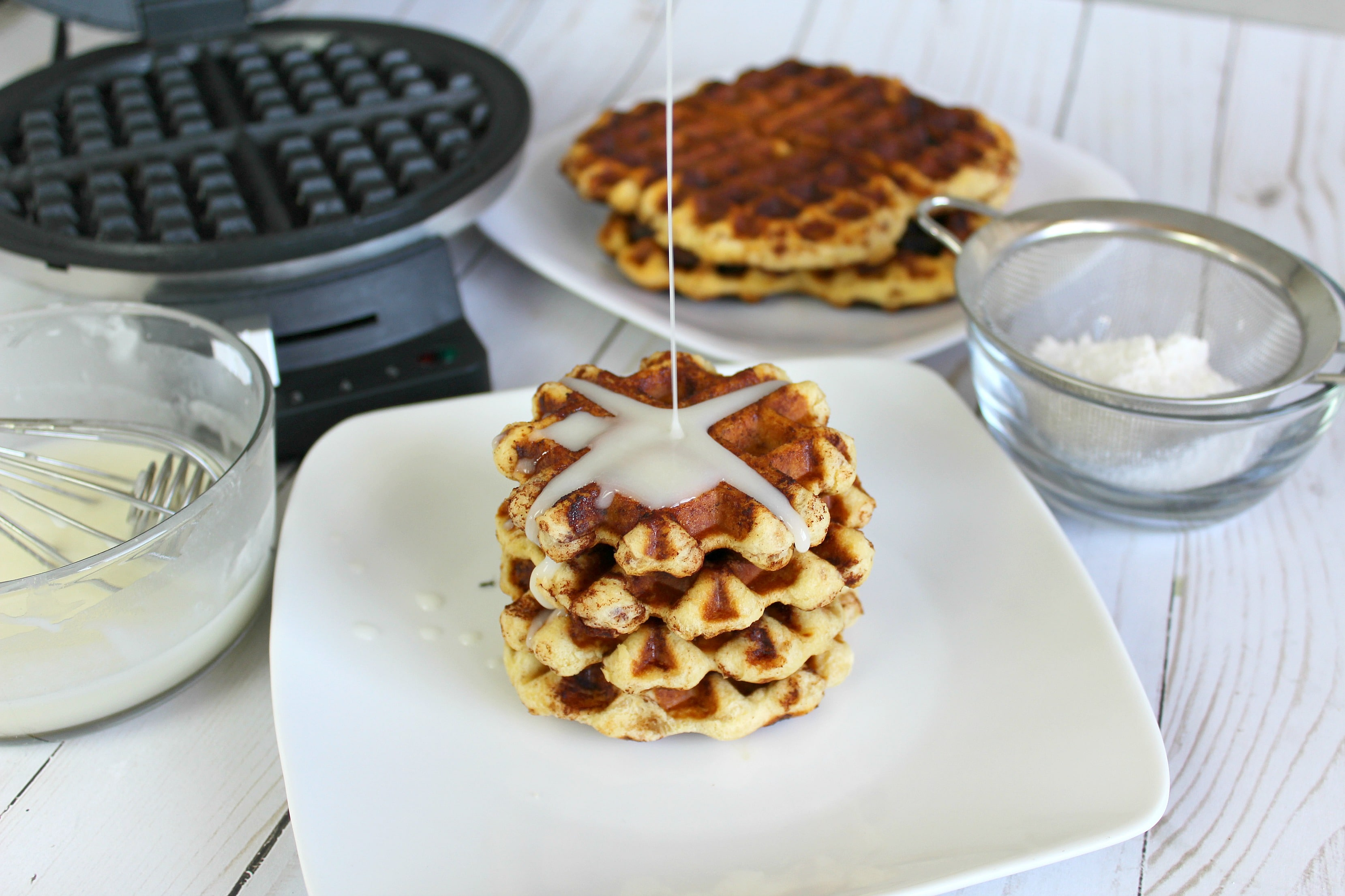 Serve these cinnamon waffles with glaze for a delicious weekend brunch