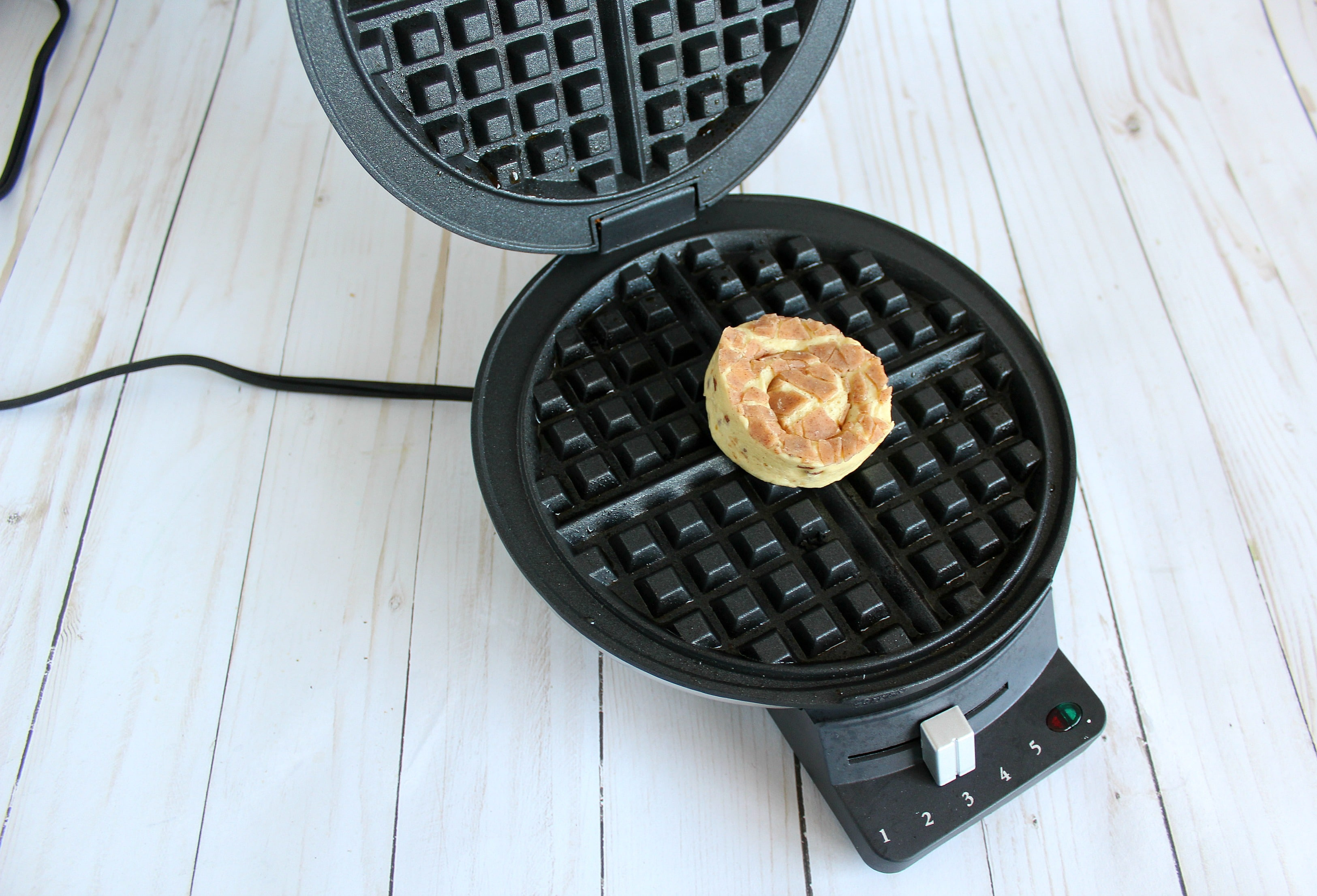 Cook one cinnamon roll in the waffle maker for about 5 minutes