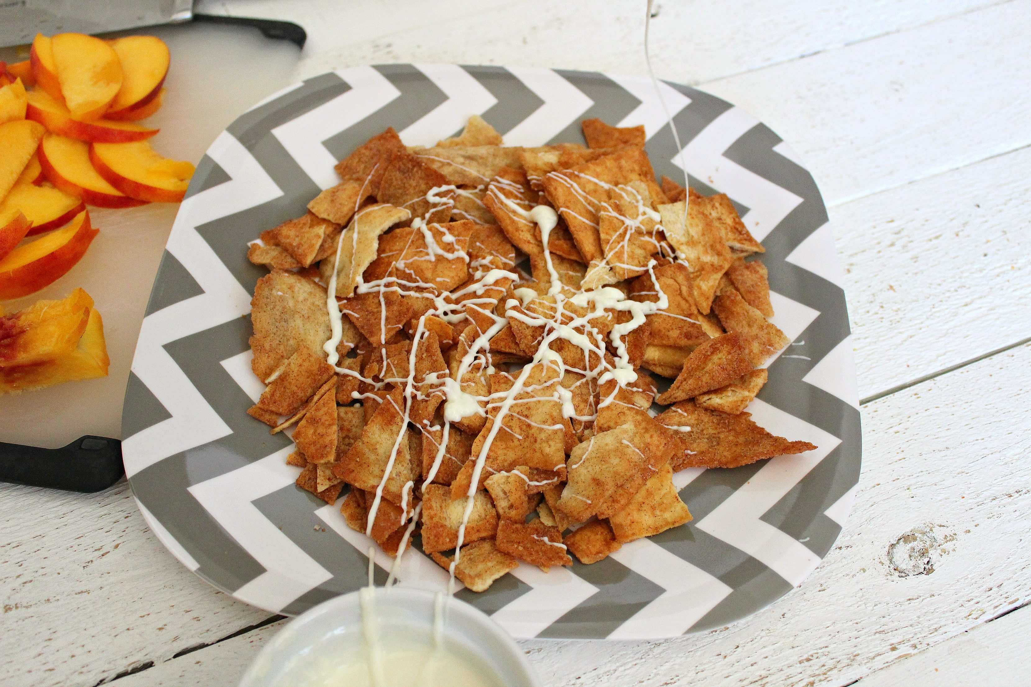 Drizzle melted white chocolate over cinnamon pita chips.