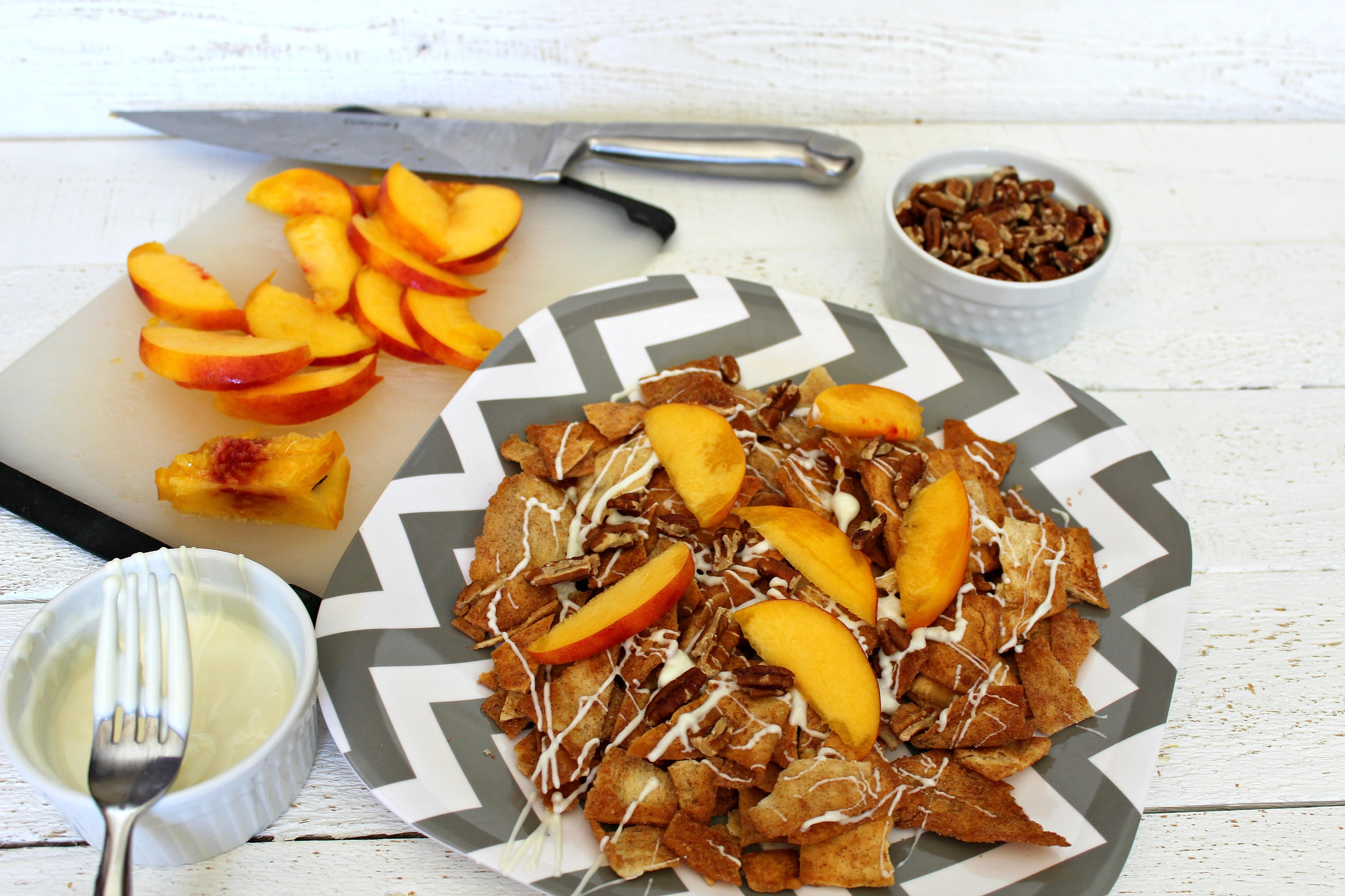 Top cinnamon pita chips with peaches and chopped pecans.