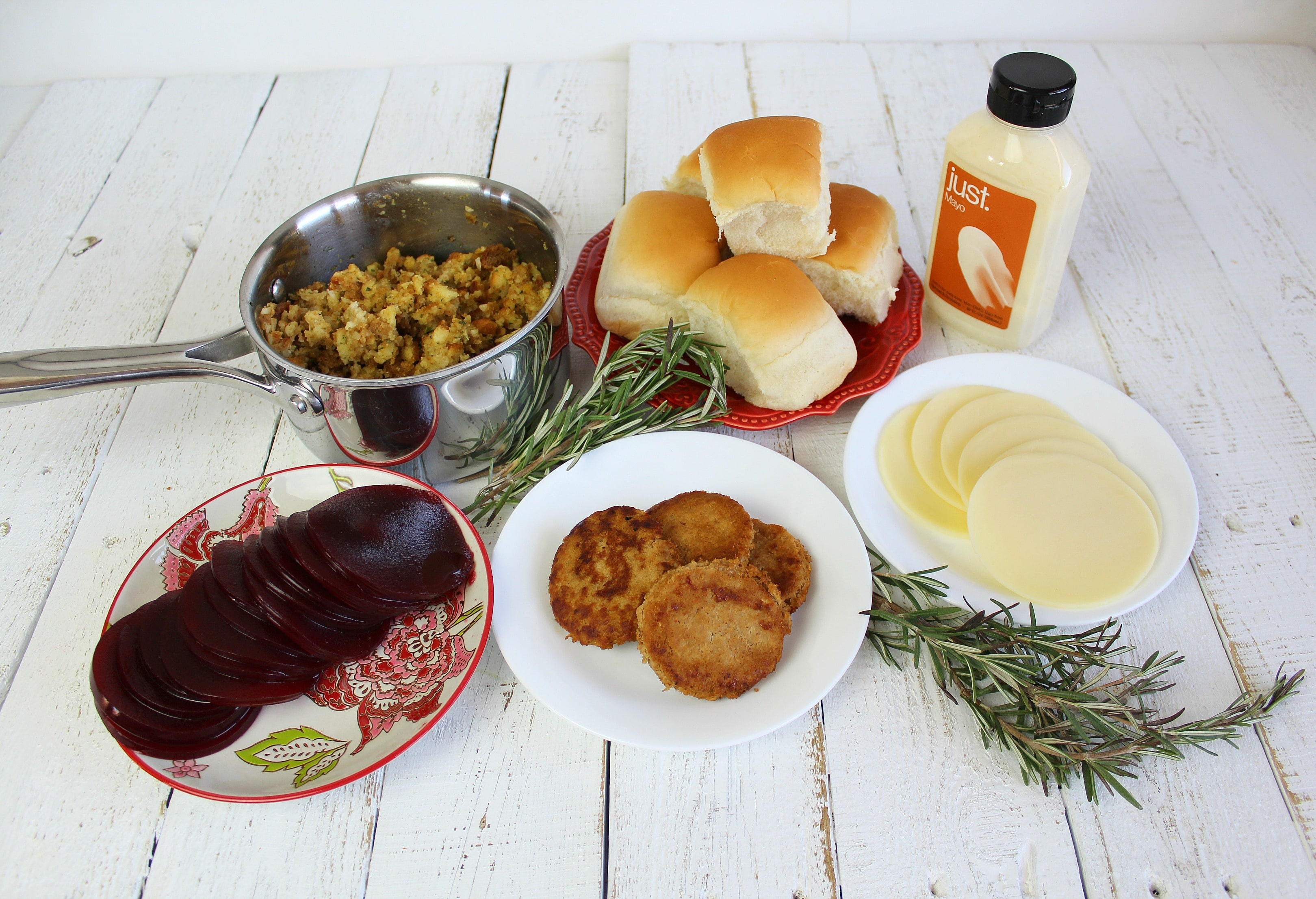 Lay out all your ingredients before cooking: turkey burgers and stuffing warmed, cheese and cranberry sauce sliced.