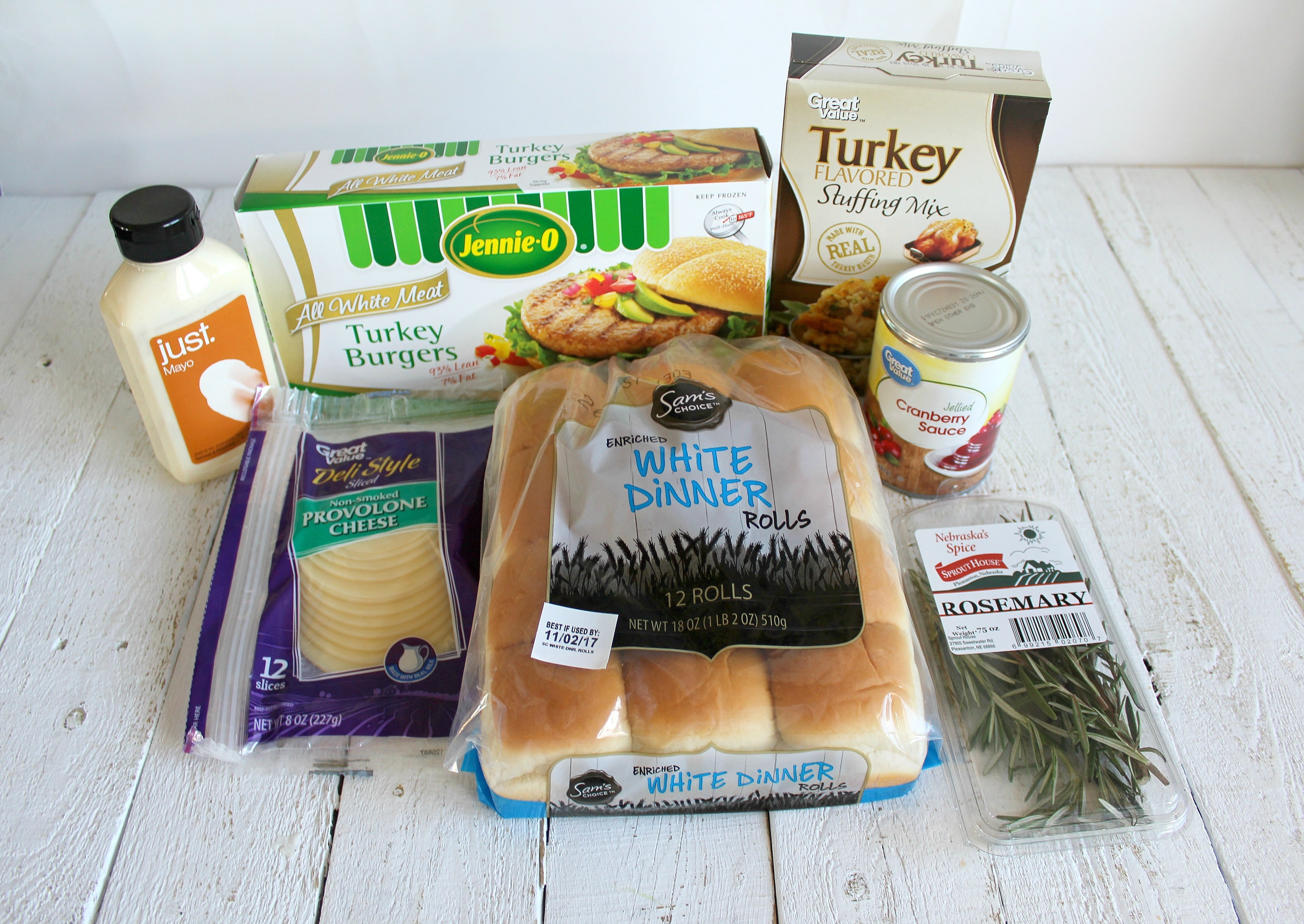 Assemble your Thanksgiving slider ingredients: frozen turkey burgers, stuffing mix, cranberry sauce, dinner rolls, provolone cheese slices, mayo and rosemary.