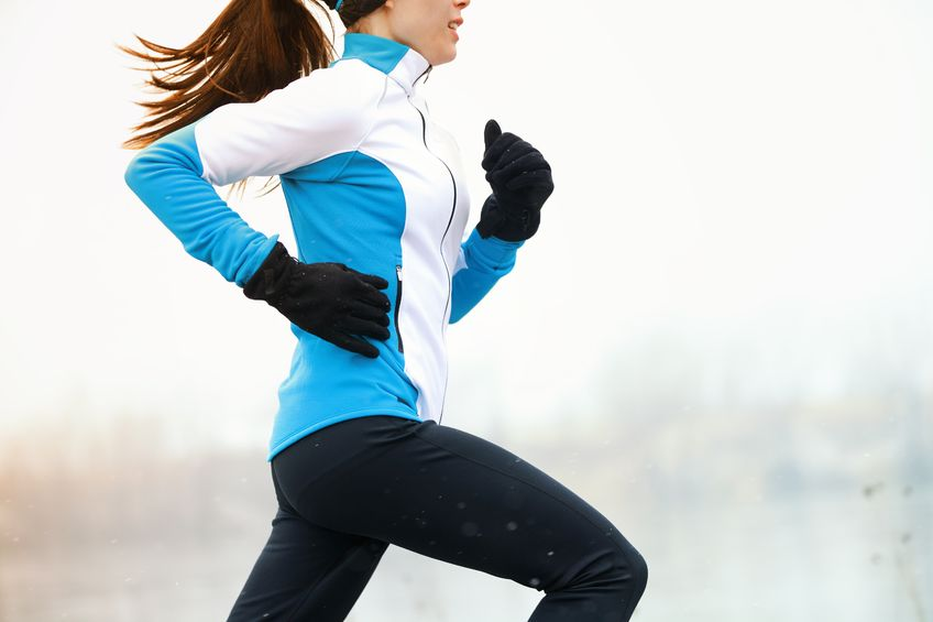 A woman going for a run in the winter.