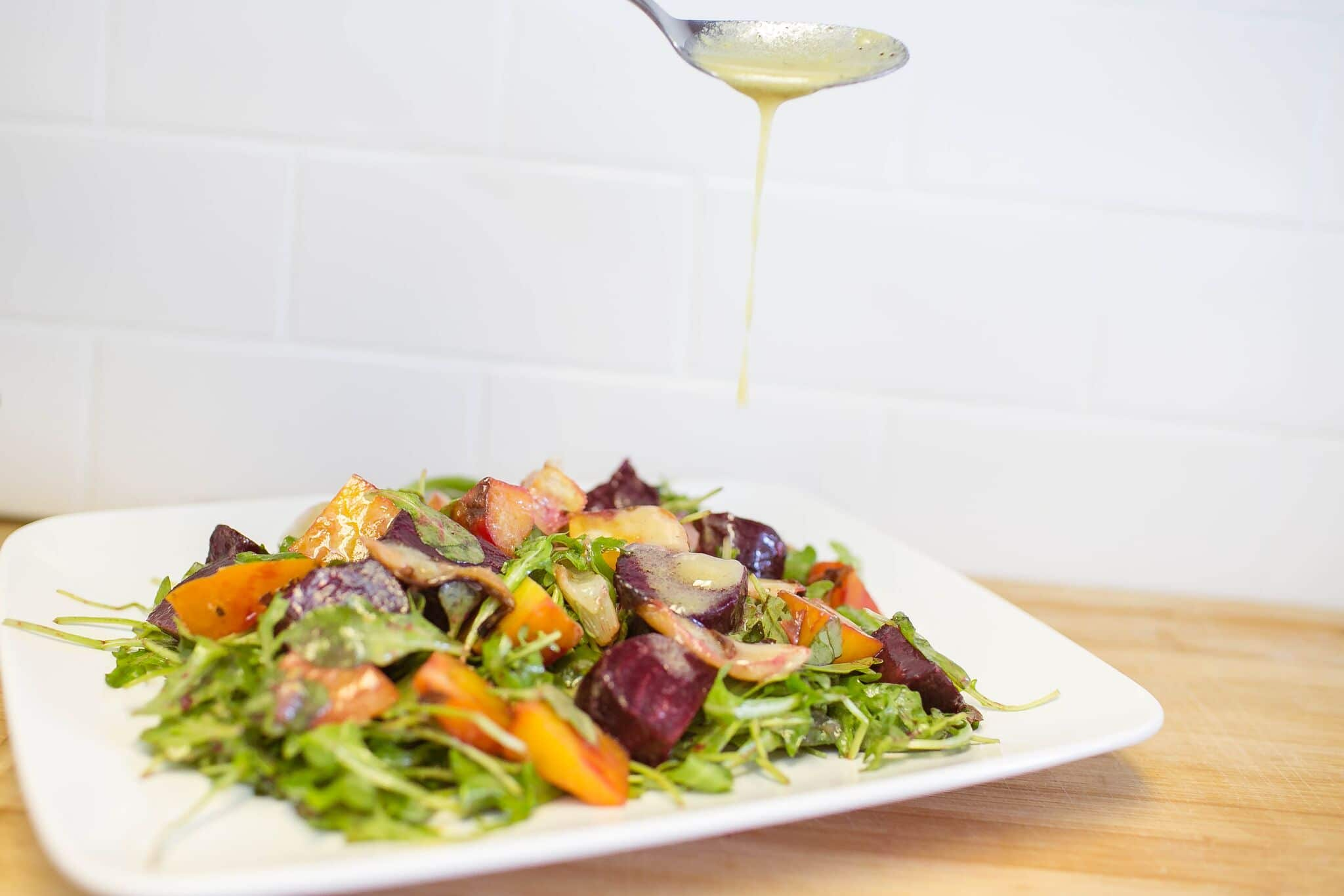 Serve roasted beets and fennel over a bed of arugula and dress with a vinaigrette