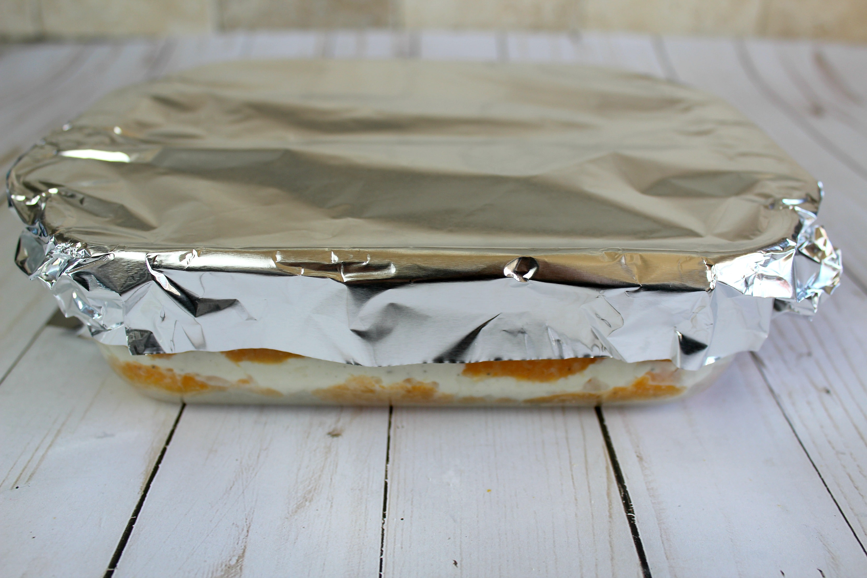 Cover the lasagna with foil before cooking.