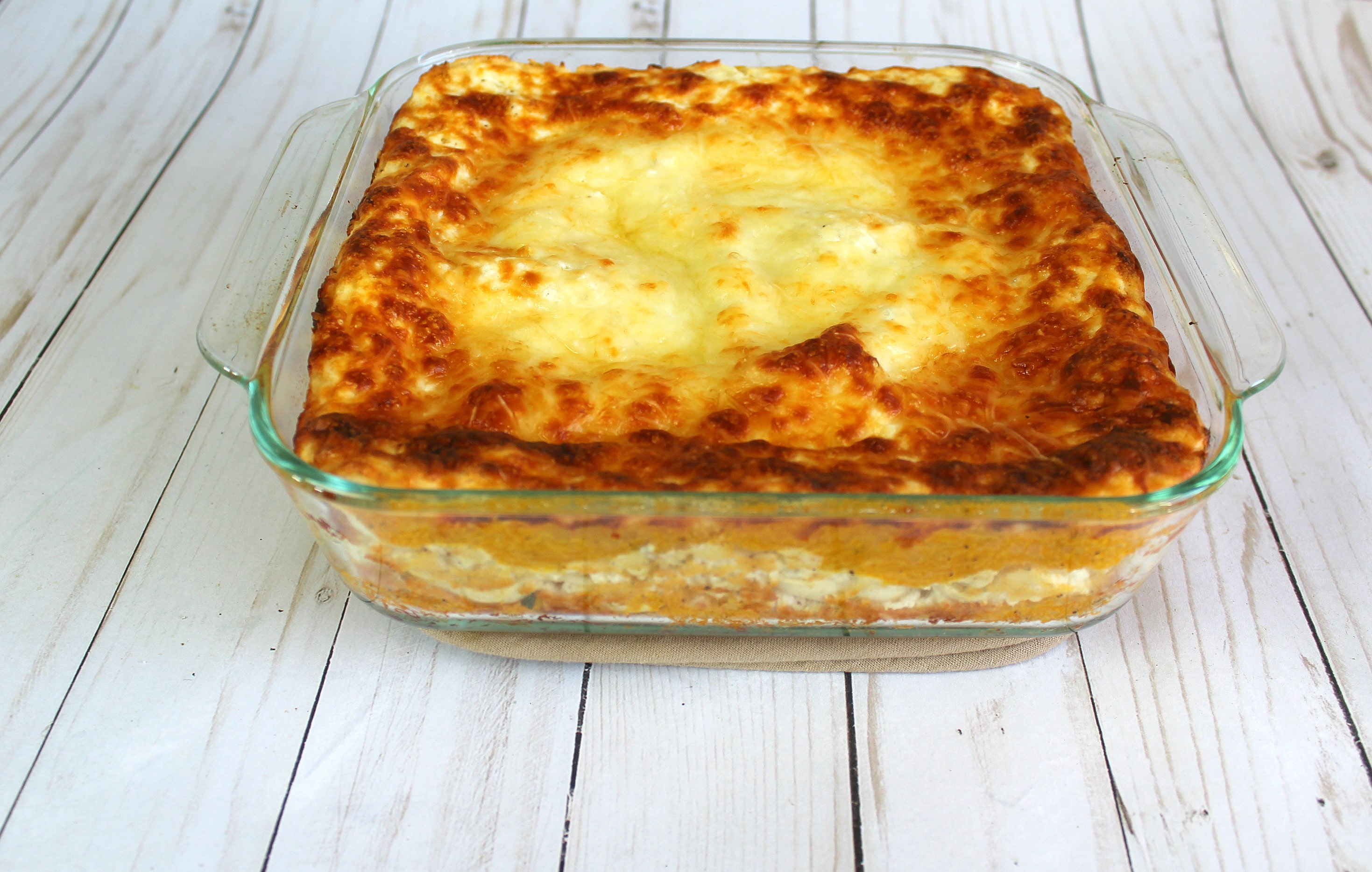 Bake lasagna for 30 minutes, then remove foil and cook for 25 more minutes uncovered.