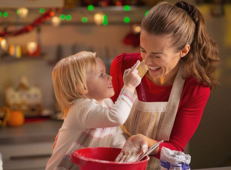 Cooking holiday cookies with your little one will get you in the Christmas spirit.