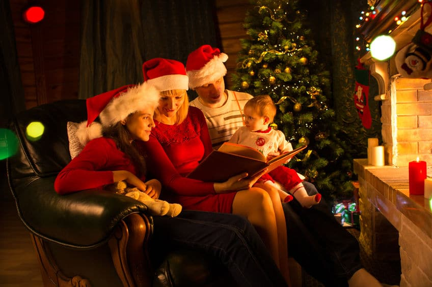 Reading holiday stories near the fireplace is fun way to get into the Christmas spirit.