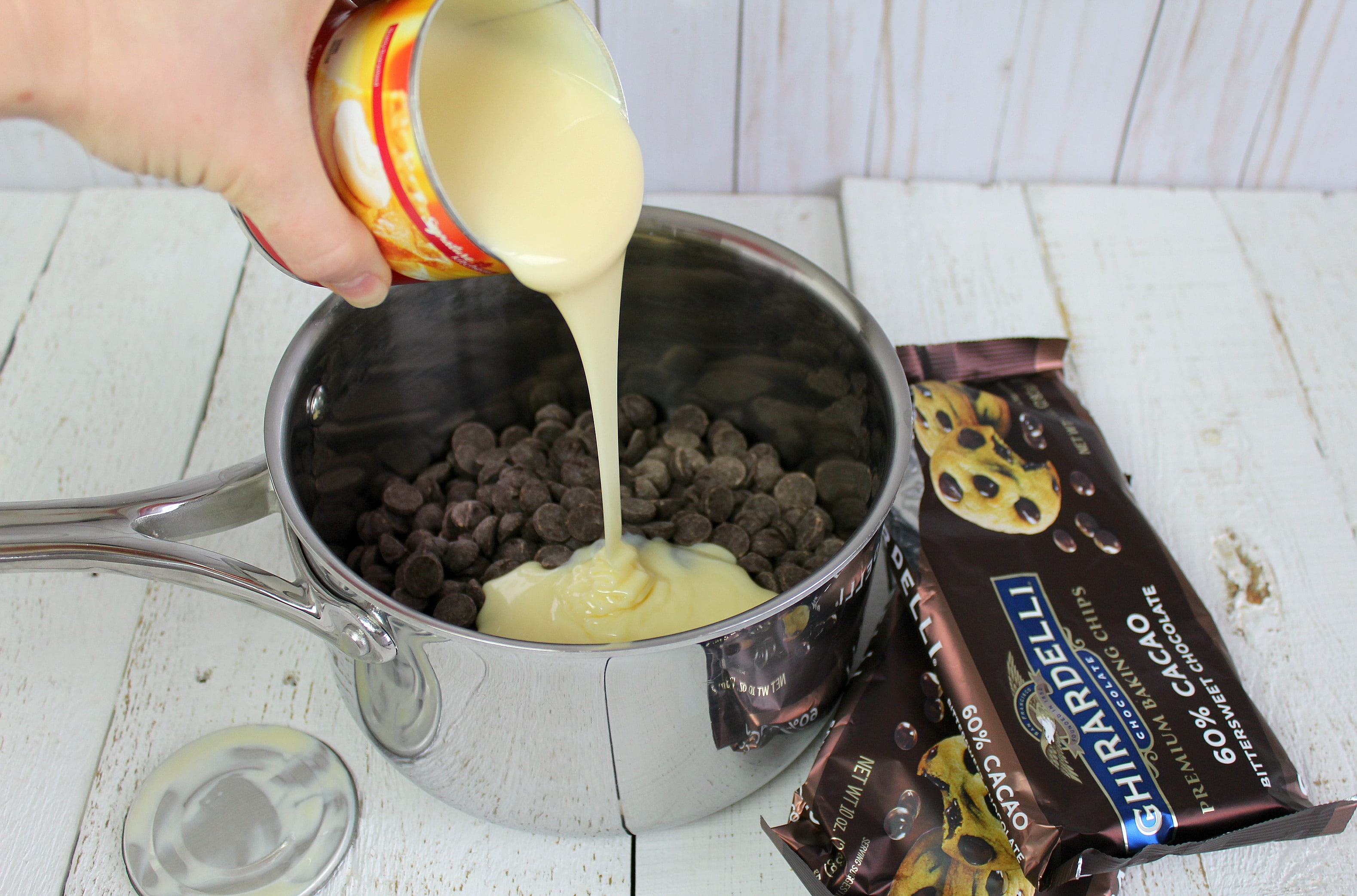 Step 2 of this Easy Peppermint Bark Fudge is to mix the condensed milk and chocolate.