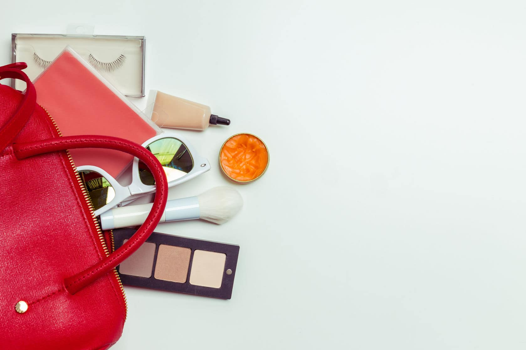 Organize your purse by removing anything you don't need every day.
