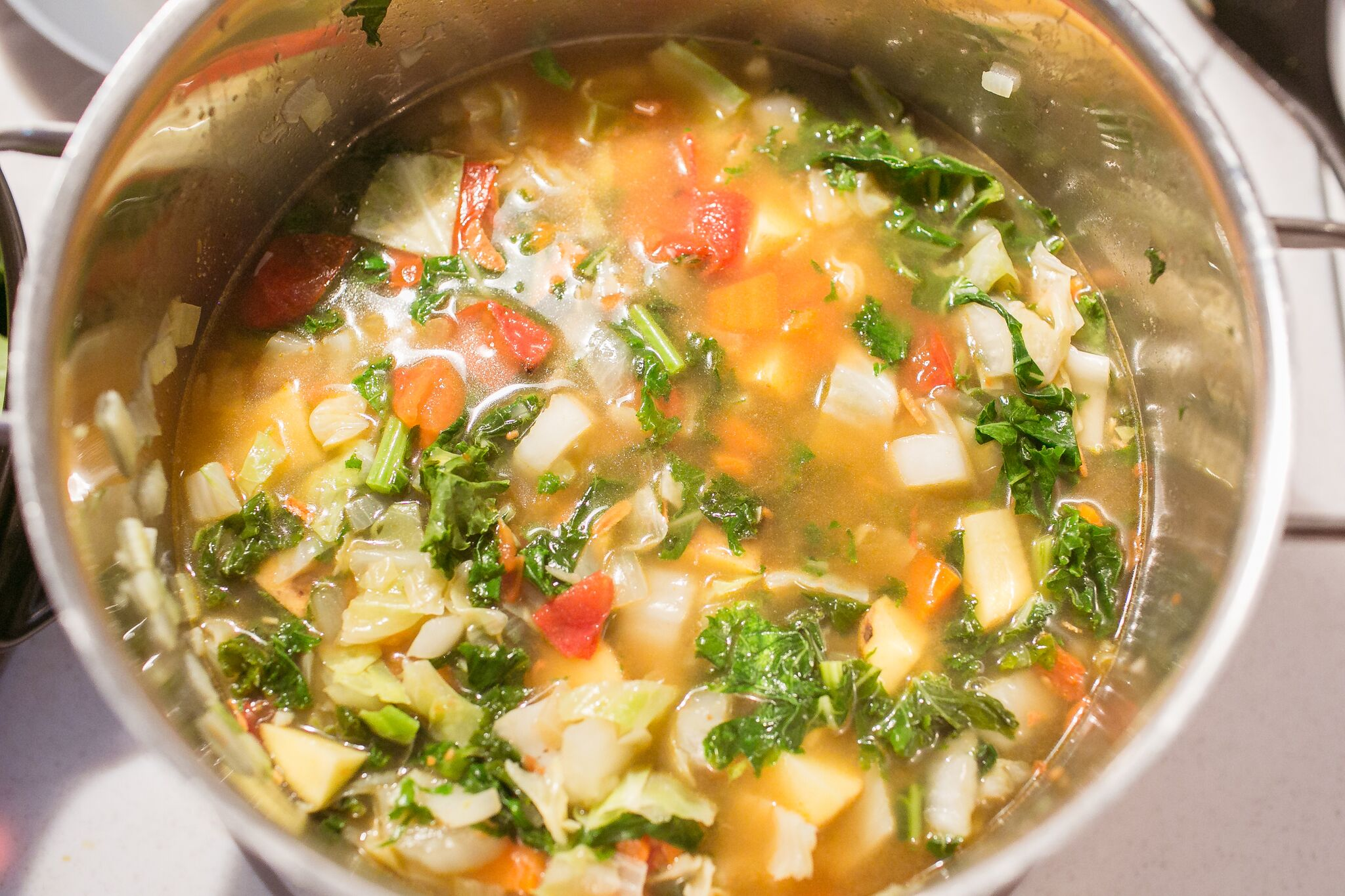Add in broth and potatoes to soup pot and stir well.