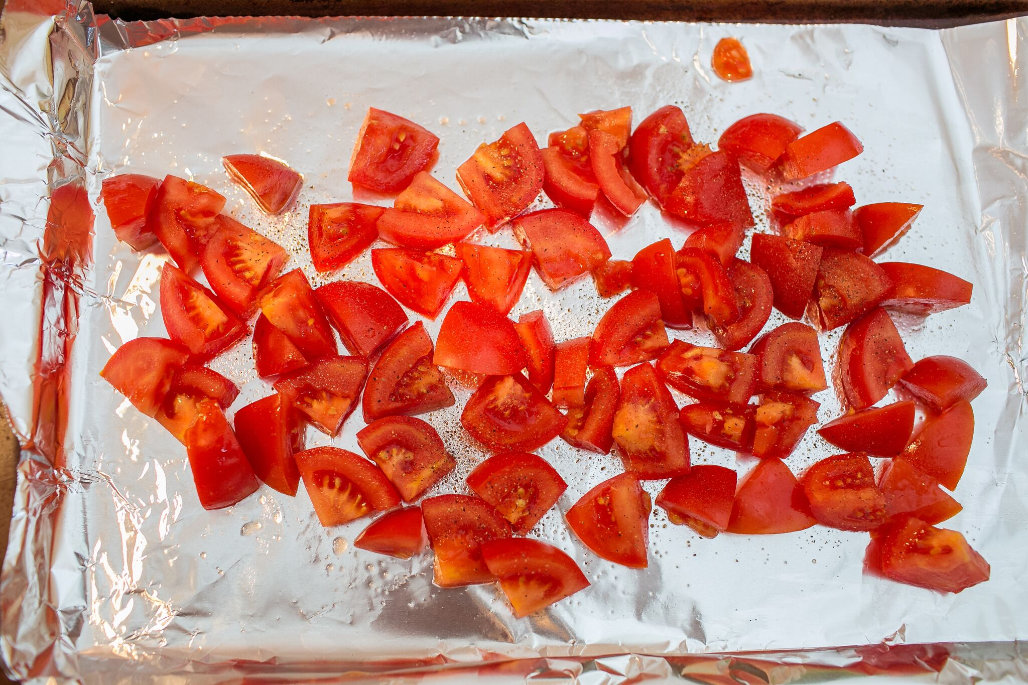 Arrange chopped tomatoes on foil lined pan with with olive oil and salt and pepper.