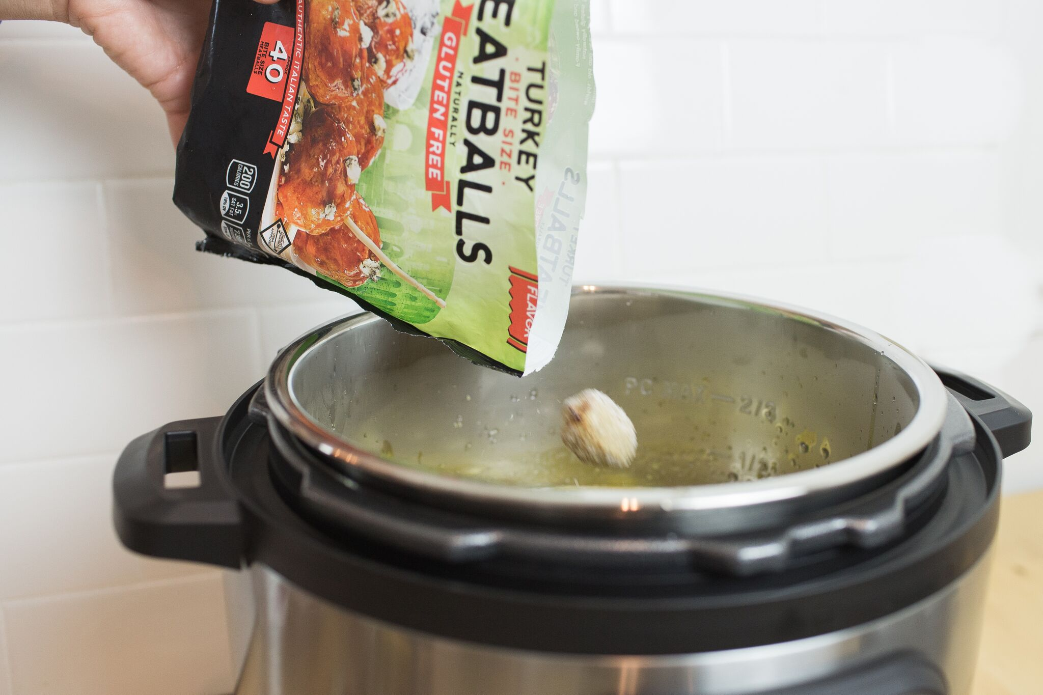 Place frozen meatballs into the Instant Pot with other ingredients.
