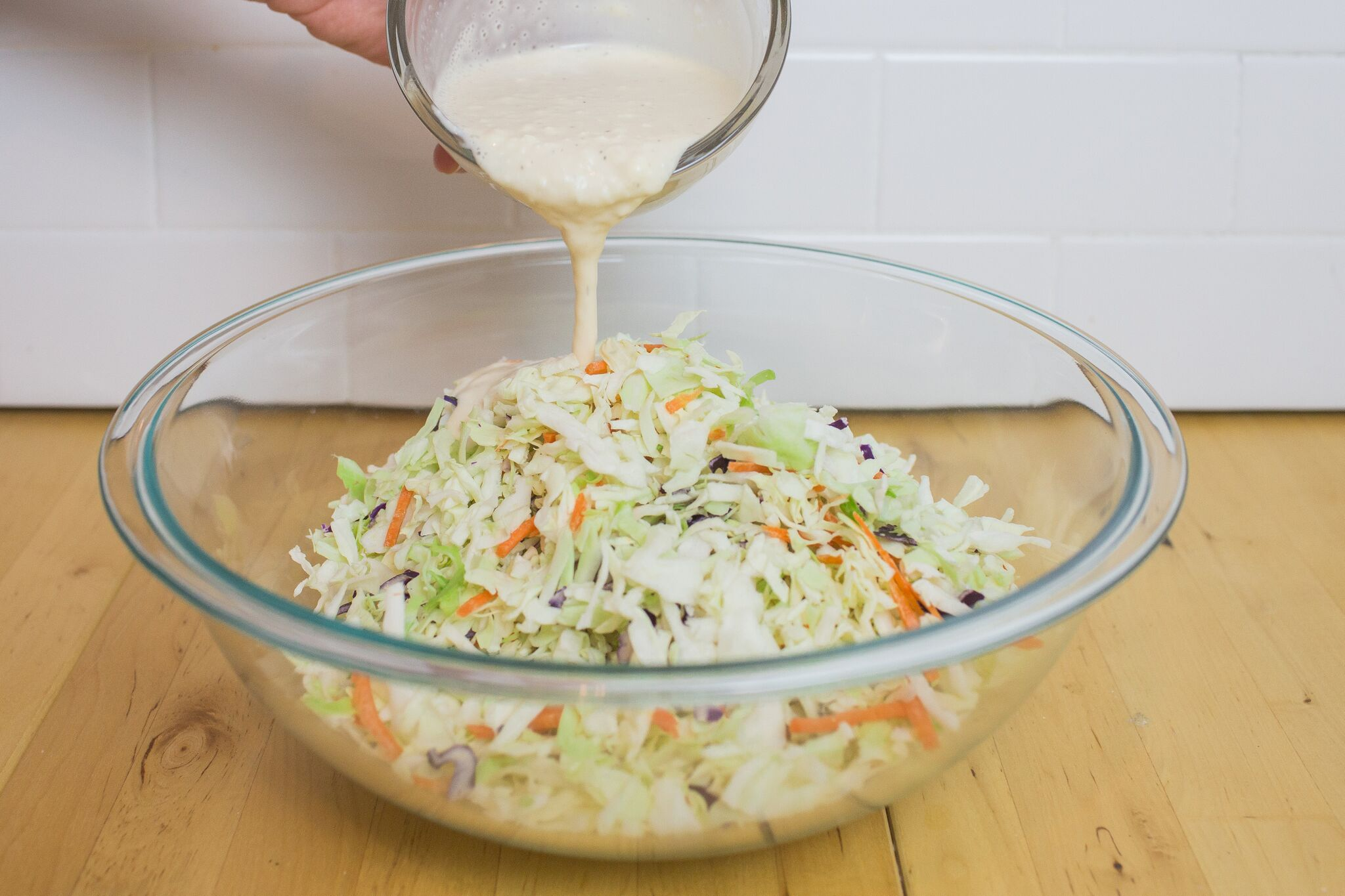 Combine the mayo, apple cider vinegar, sugar, salt and pepper then pour over the slaw mix.