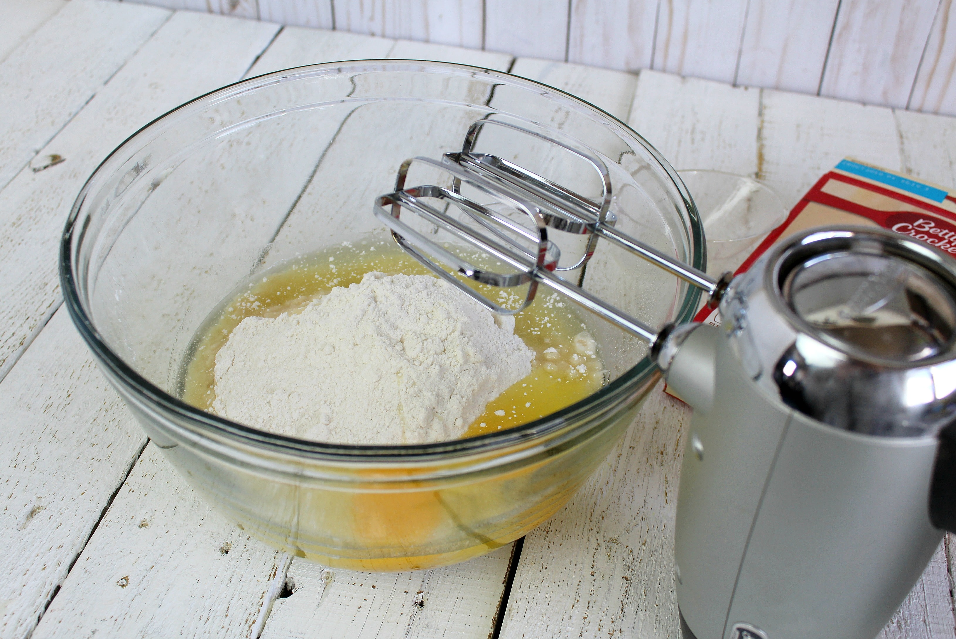 In a large bowl, beat together with electric mixer the white cake mix, oil, and eggs until well combined.