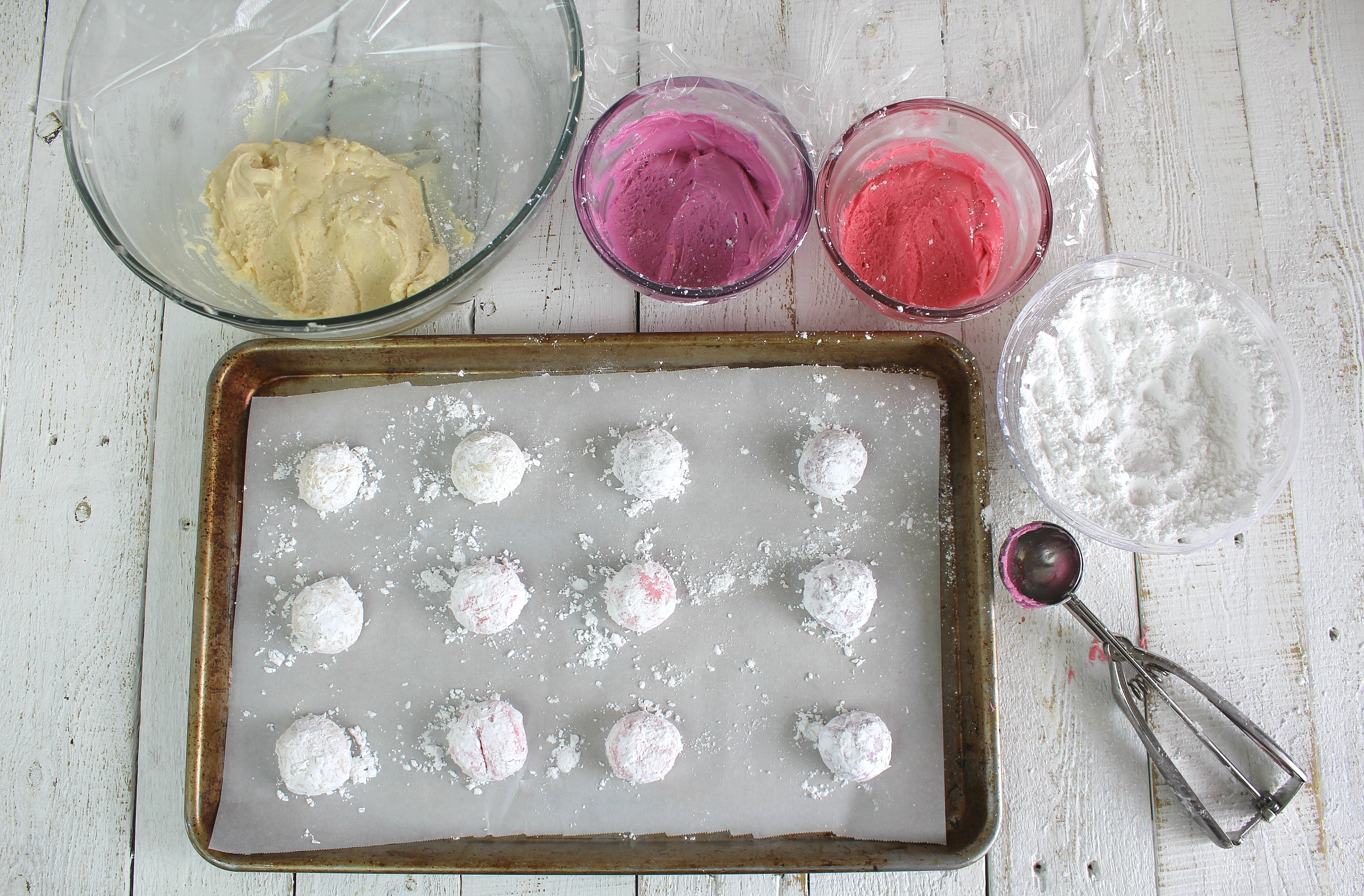 Roll dough into balls and coat in powdered sugar then place on cookie sheet.