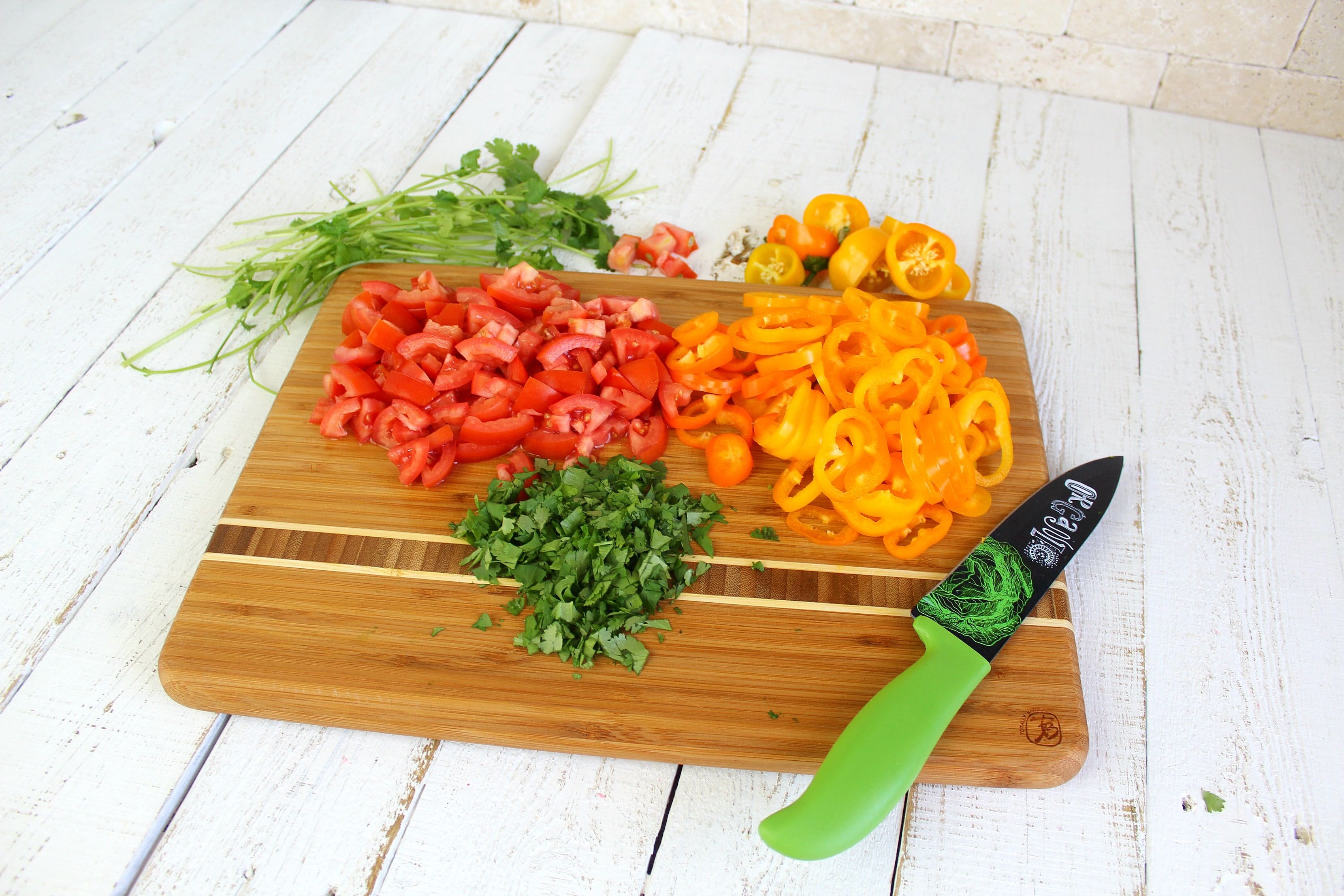 Cut peppers into rings, chop tomatoes into bite-sized pieces, and chop cilantro finely.