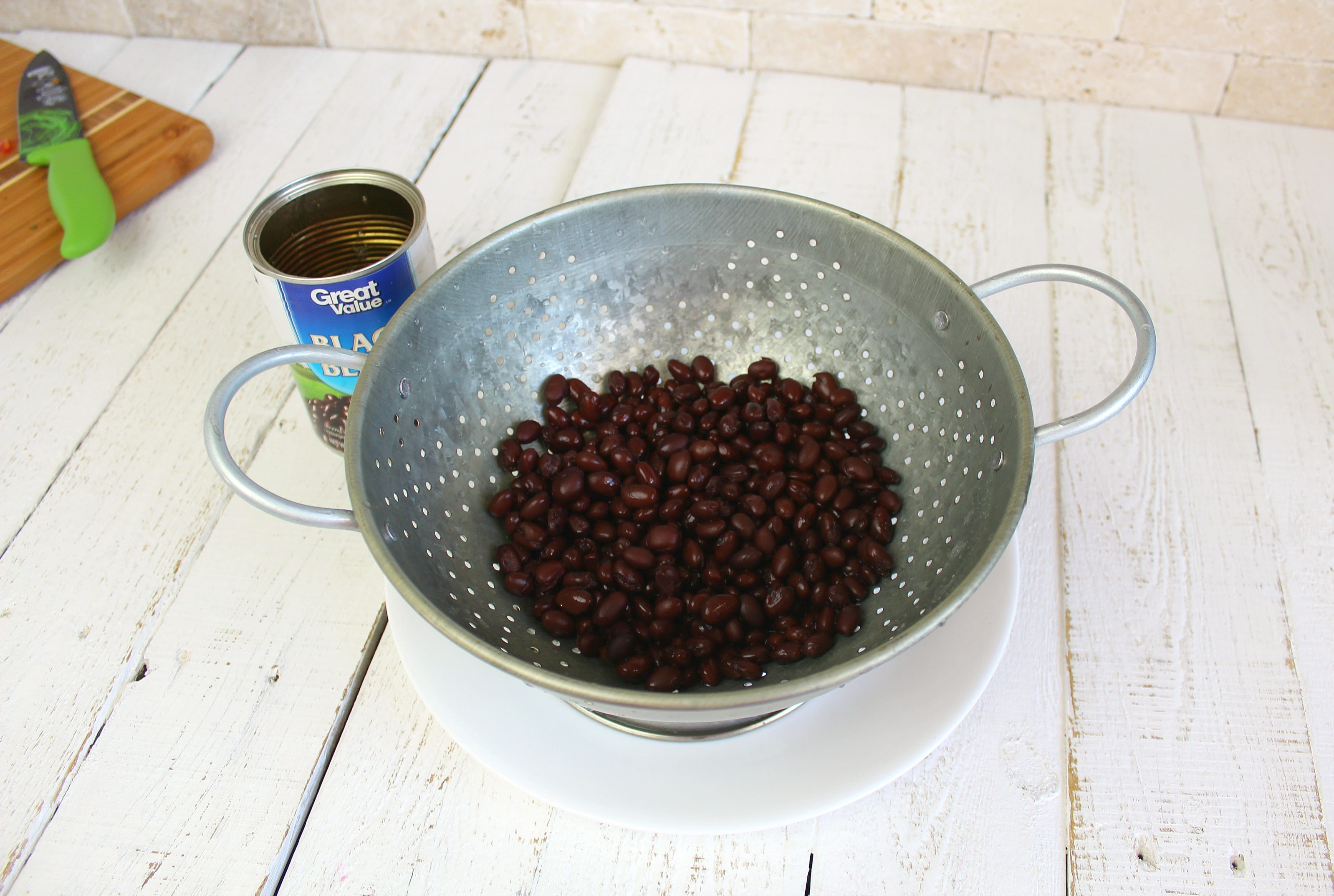 Drain and rinse black beans in colander.