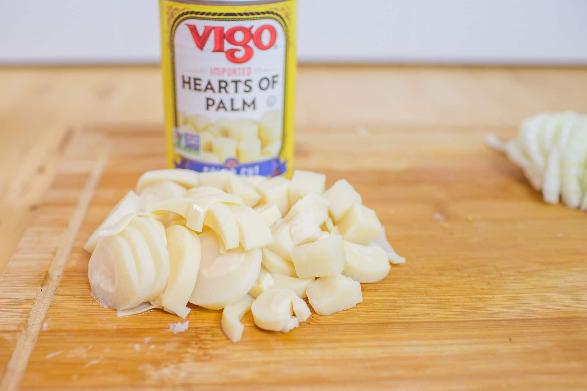 Slice hearts of palm into bite size pieces.