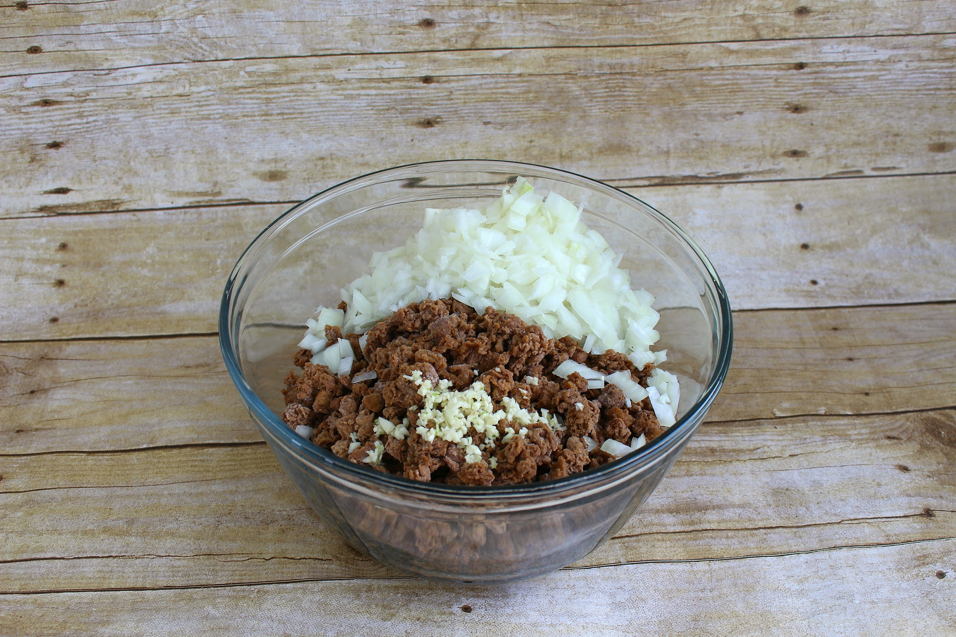 "Add onions and garlic to ""meat"" mixture."